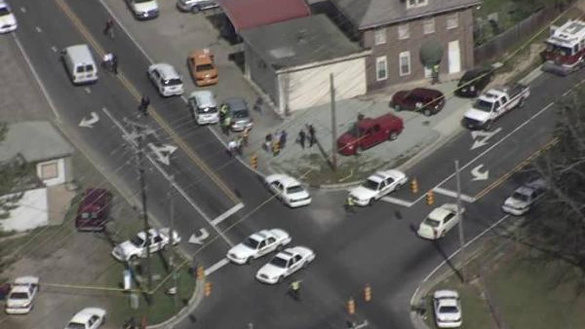 March 23, 2012: A gunman killed two people at a tire shop in Durham, N.C., before fleeing by car.