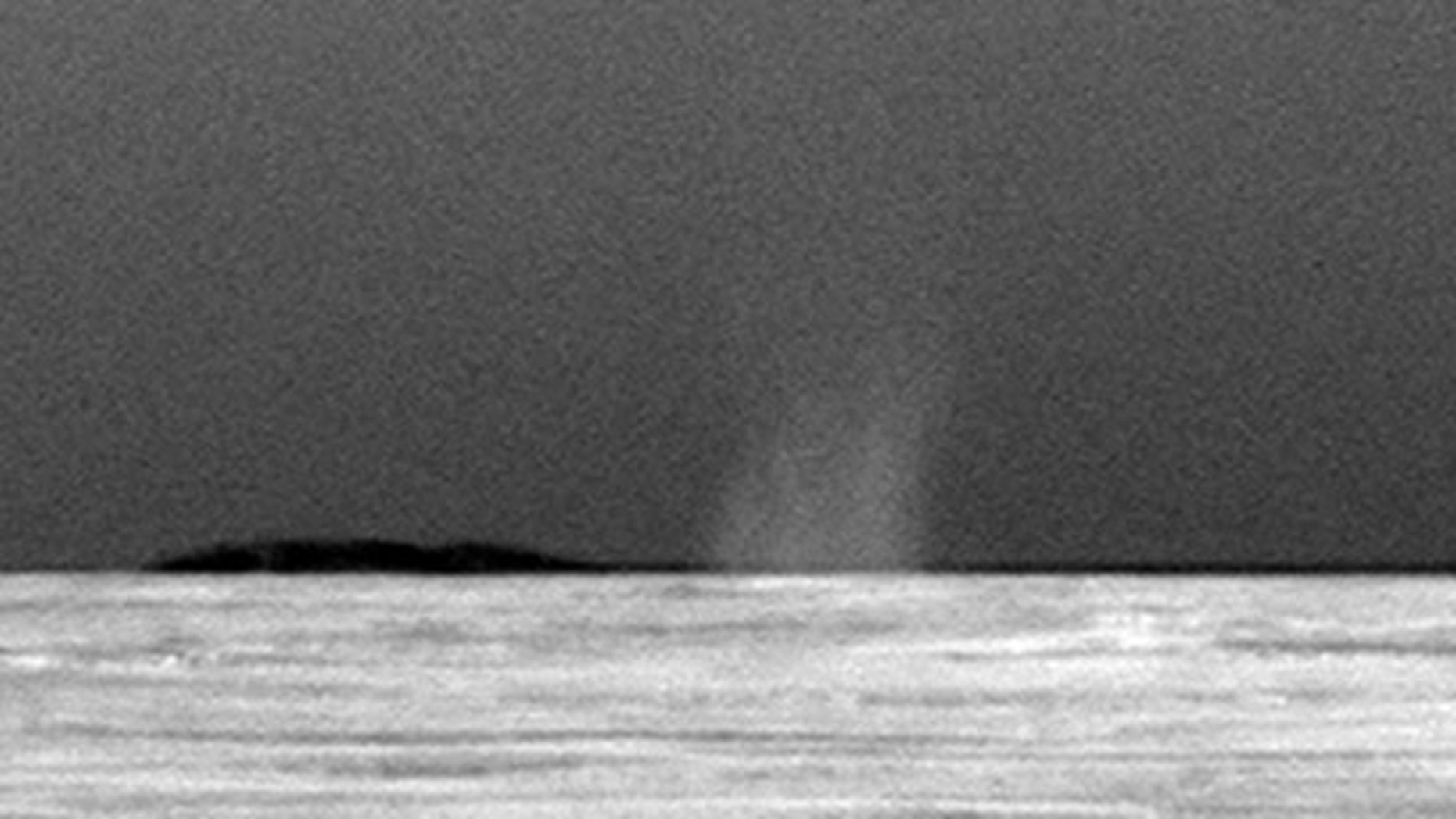 This photo taken July 15, 2010 shows the first dust devil observed by NASA's Mars Exploration Rover Opportunity in the rover's six-and-a-half years on Mars.
