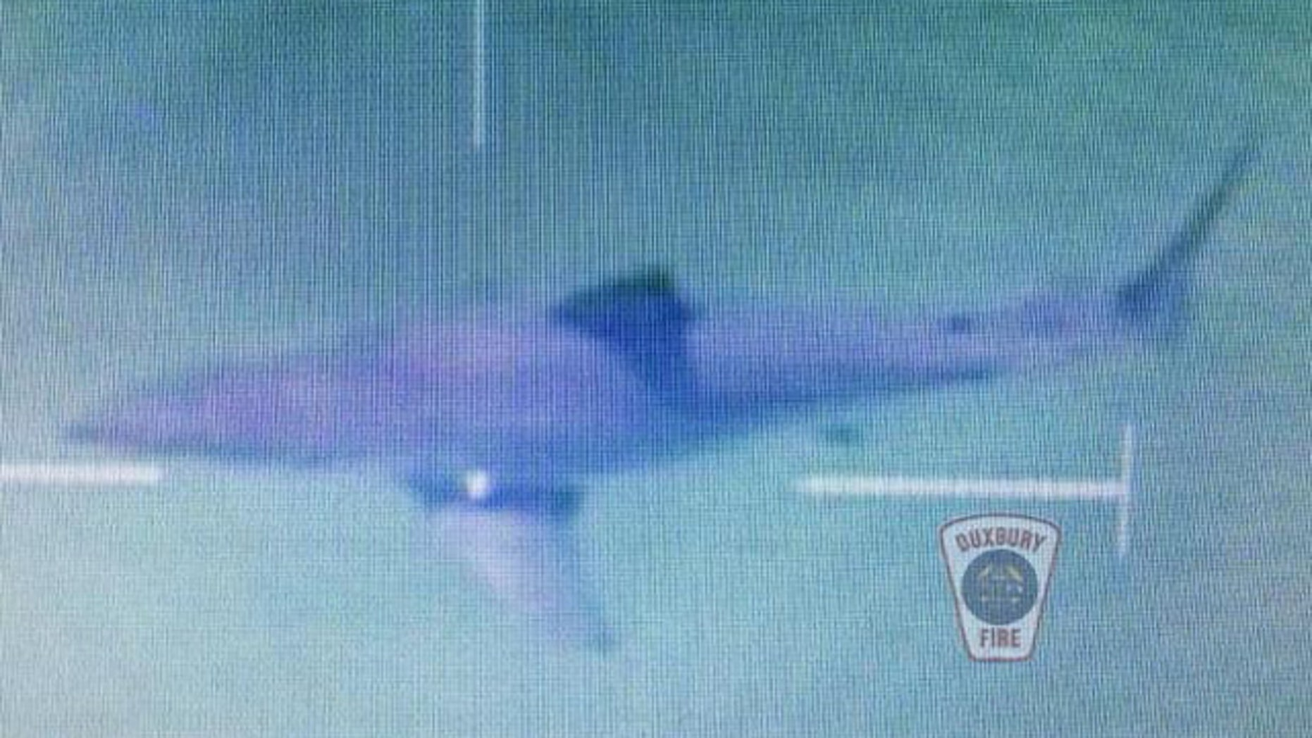August 25, 2014: This photo shows a great white shark that was spotted by a Massachusetts State Police helicopter near a beach at Duxbury, Mass. The sighting prompted the beach to be closed for approximately two hours. (MyFoxBoston.com/Duxbury Fire Department)