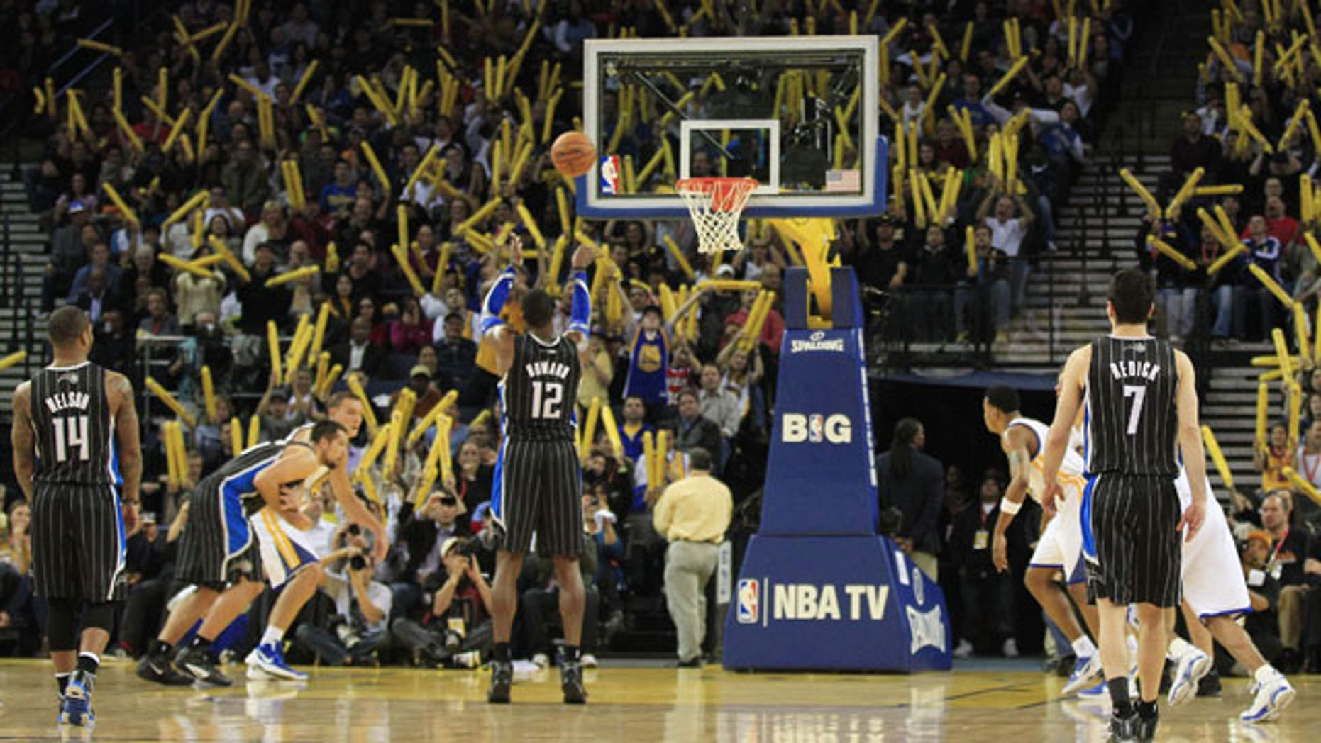 January 12, 2012: Orlando Magic's Dwight Howard (12) takes a free throw against the Golden State Warriors during the second half of an NBA basketball game in Oakland, Calif.