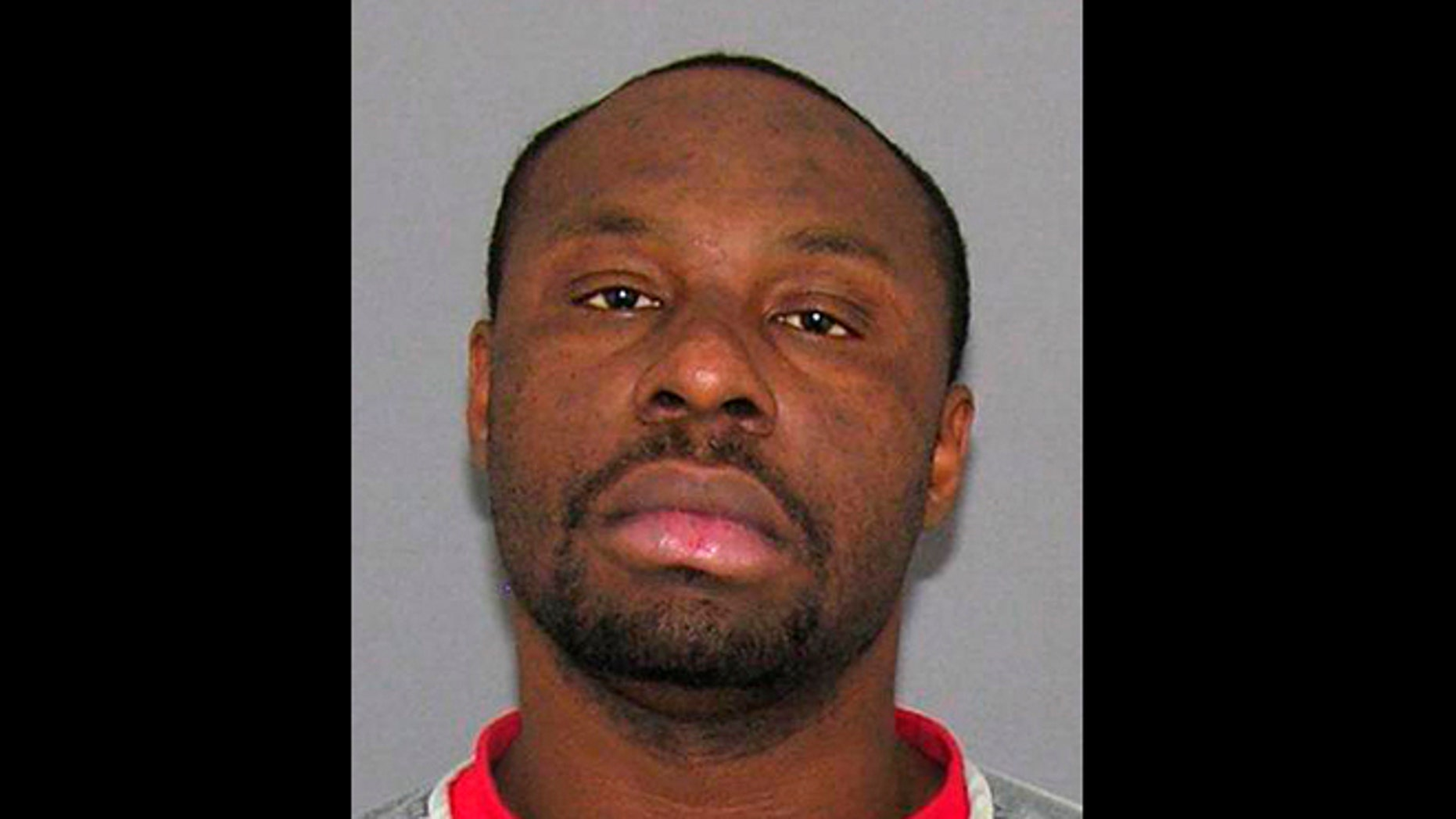 This undated file photo provided by the Hamilton County Sheriff's Department shows Ricardo Woods, of Cincinnati. Woods was found guilty Thursday, May 16, 2013, in the shooting death of a man who authorities say identified his assailant by blinking his eyes while paralyzed and hooked up to a ventilator.