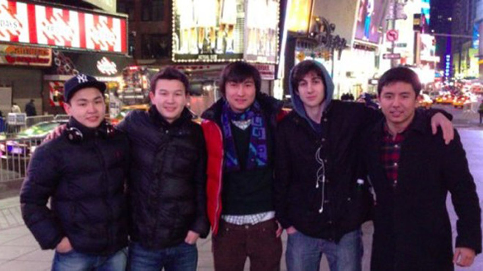 Dzhokhar Tsarnaev and older brother Tamerlan reportedly planned to drive to NYC after their deadly Boston attack to detonate devices in Times Square, which Dzhokhar visited earlier with friends. None of the others pictured here are suspected of being involved in the Tsarnaevs' plot. Dias Kadyrbayev is standing left of Dzhokhar's right in the blue scarf, and Azamat Tazhayakov is immediately left of Kadyrbayev.