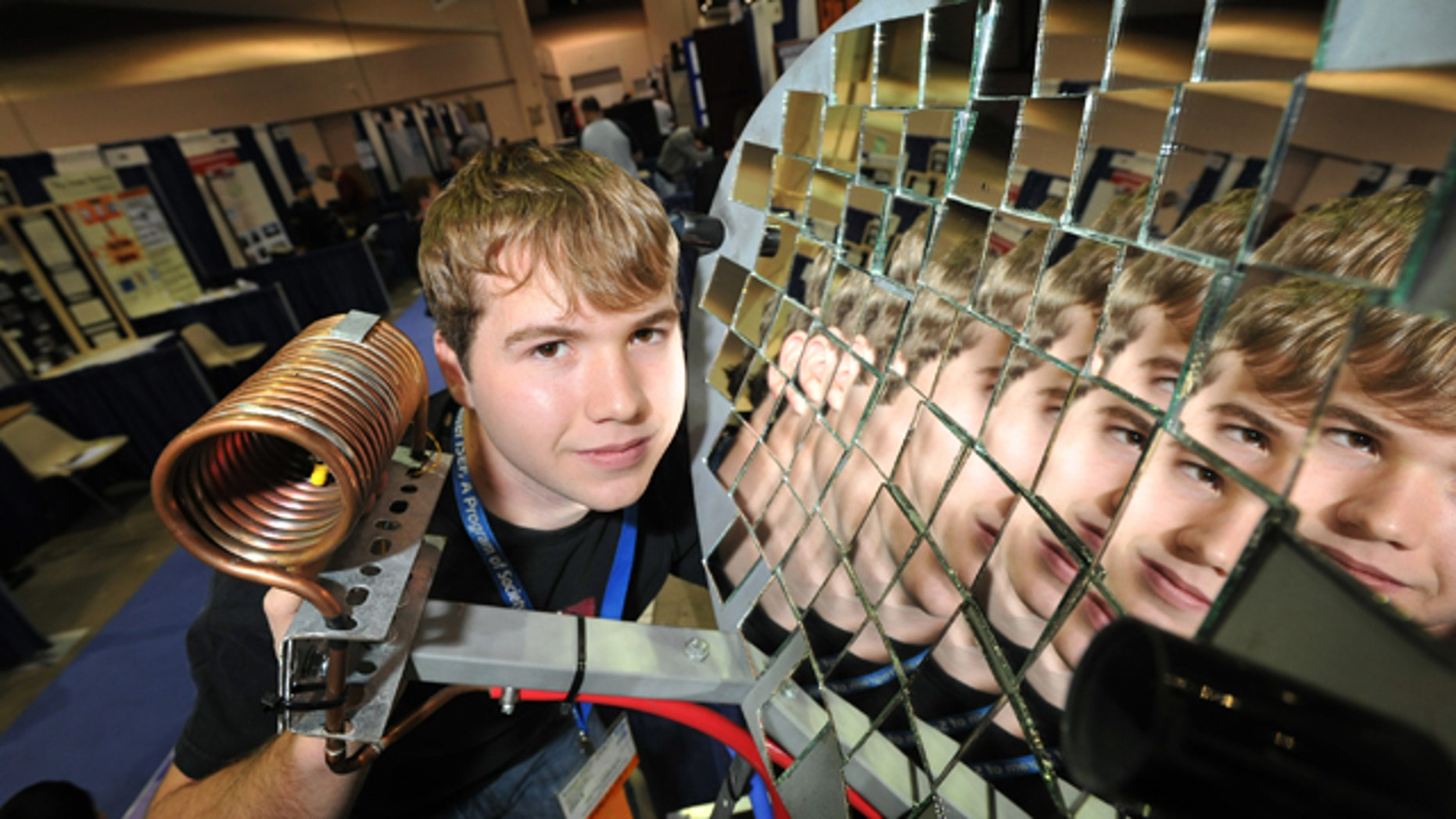 May 16, 2011: Seth Fisher, 16, from Bernville, Pa., demonstrates his solar heat concentrator at the Intel International Science and Engineering Fair, the world's largest pre-college science competition, in Reno, Nev.