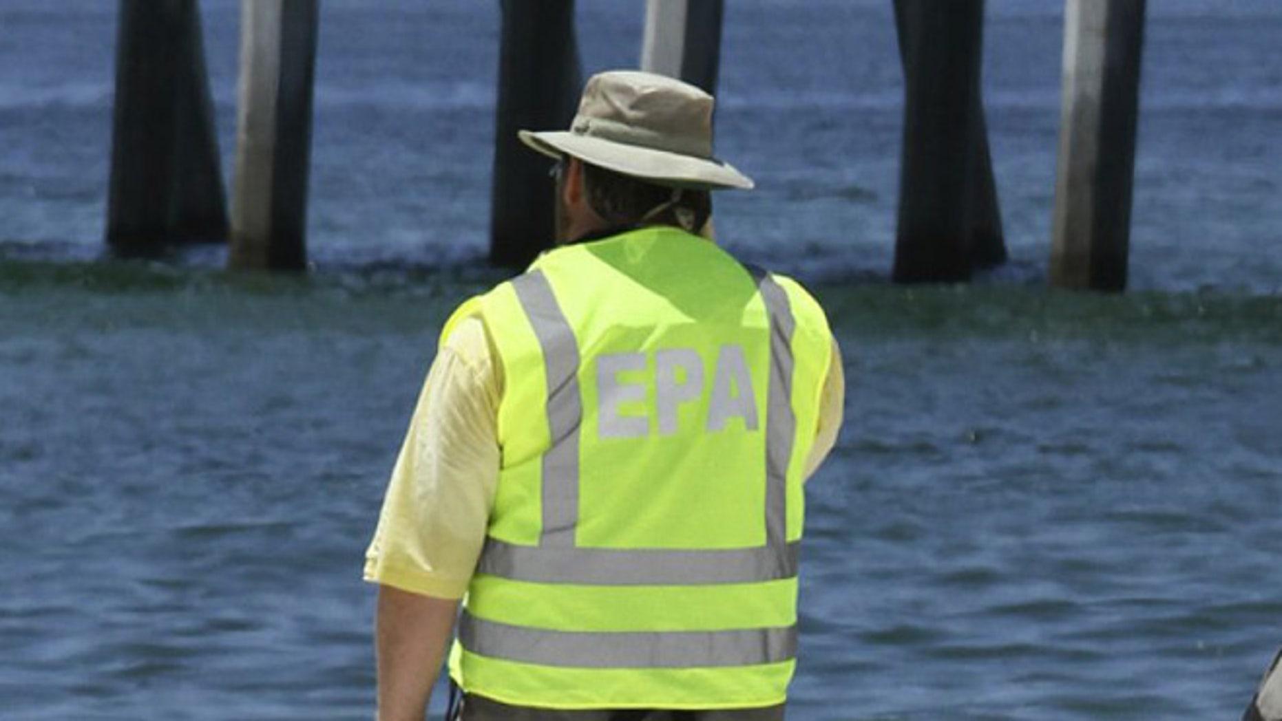 FILE: 2010: An EPA worker monitoring a beach in Pensacola, Florida.