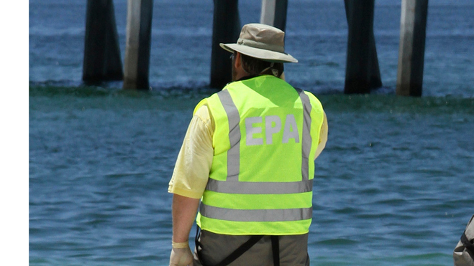 FILE: 2010: An EPA worker monitoring a beach in Pensacola, Florida.