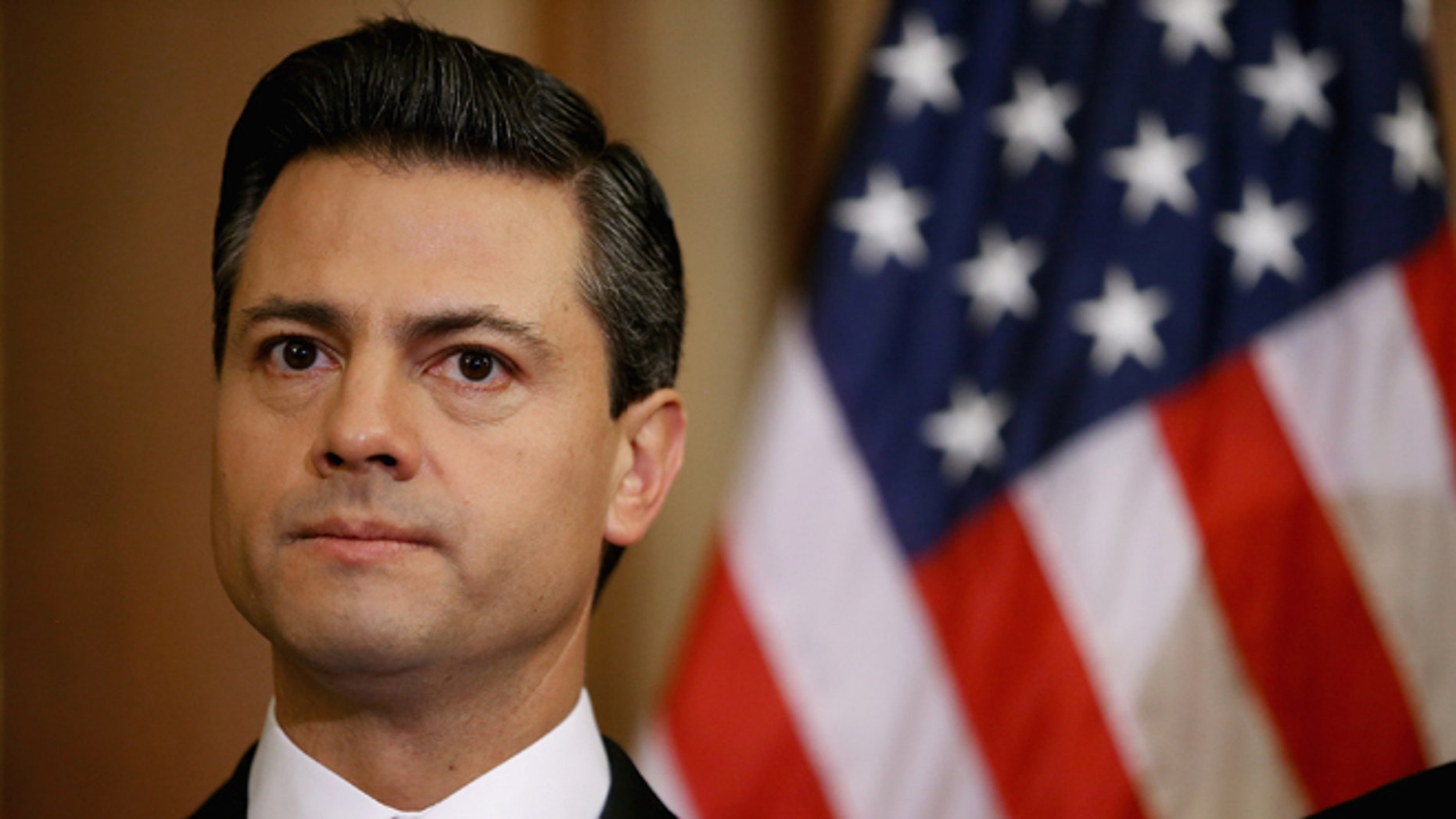 WASHINGTON, DC - NOVEMBER 27:  Mexican President-Elect Enrique Pena Nieto delivers brief remarks after meeting with Democratic members of the House in the Rayburn Room at the U.S. Capitol November 27, 2012 in Washington, DC. Nieto, of Mexico's Institutional Revolutionary Party, will also visit the White House and meet with President Barack Obama today, days before he takes office on December 1.  (Photo by Chip Somodevilla/Getty Images)