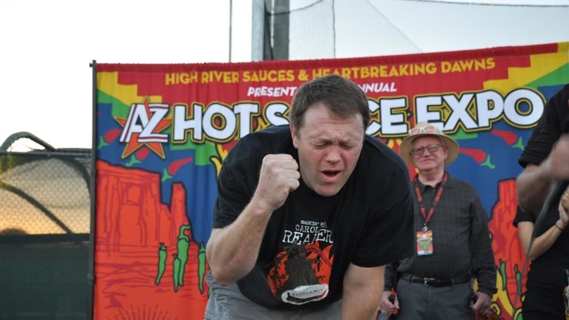 Greg Foster of Irvin, Calif. feels the burn after consuming 120 grams of Carolina Reaper peppers.