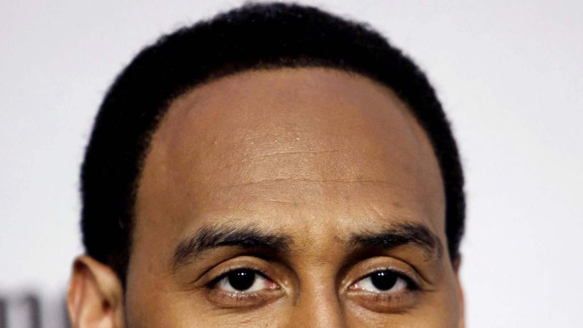 FILE - In this Saturday, Dec. 12, 2009 file photo, Stephen A. Smith arrives at Spike TV's Video Game Awards in Los Angeles. ESPN says it has suspended sportscaster Stephen A. Smith, Tuesday, July 29, 2014 for a week because of comments about domestic abuse suggesting women should make sure they don't provoke attacks.  (AP Photo/Matt Sayles, File)