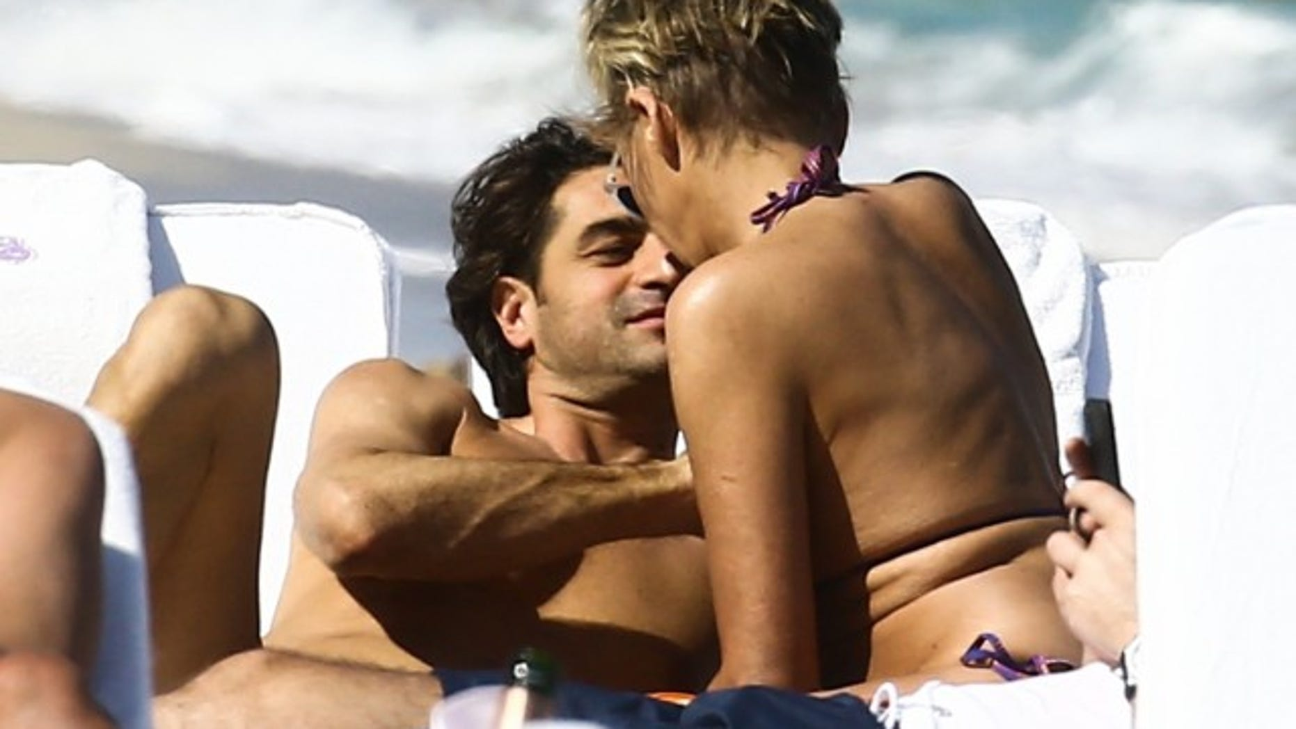 Sharon Stone and her boyfriend enjoy a date on the beach.