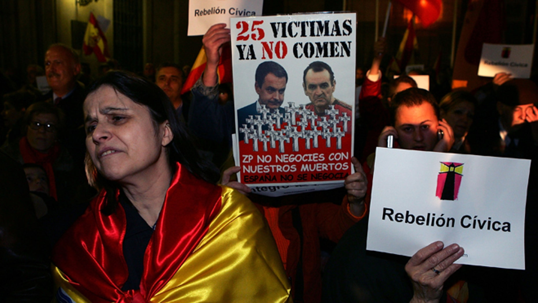 A woman wears the Spanish flag during a protest in front of the Town Hall against the house arrest granted to the hunger striking prisoner Inaki de Juana Chaos on March 2, 2007 in Madrid, Spain. (Photo by Denis Doyle/Getty Images)