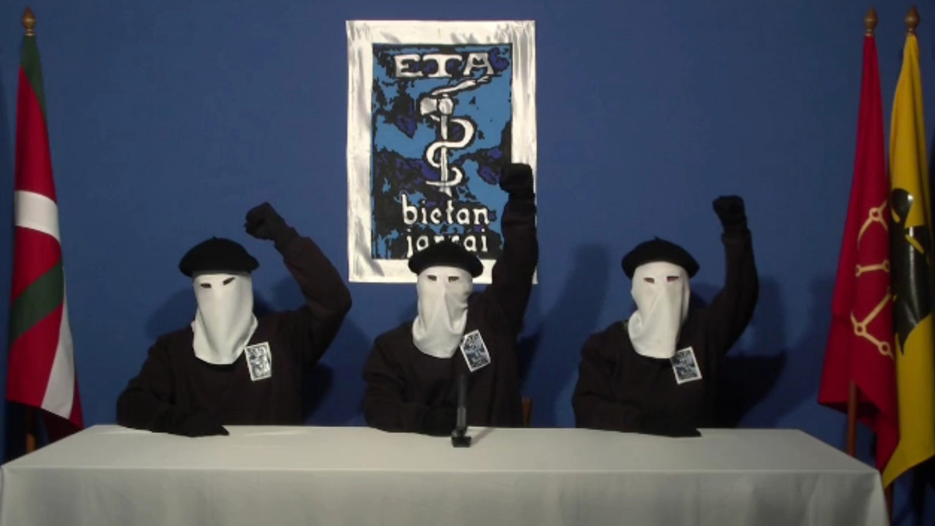 In this image made from video provided on Thursday, Oct. 20, 2011, masked members of the Basque militant group ETA gesture following a news conference at an unknown location. The Basque militant group ETA called an end to a 43-year violent campaign for independence on Thursday, Oct. 20, 2011 and now wants to open talks with Spain and France, a ground-breaking move that could pave the way for ending Europe's last armed militancy. (AP Photo/Gara via APTN)