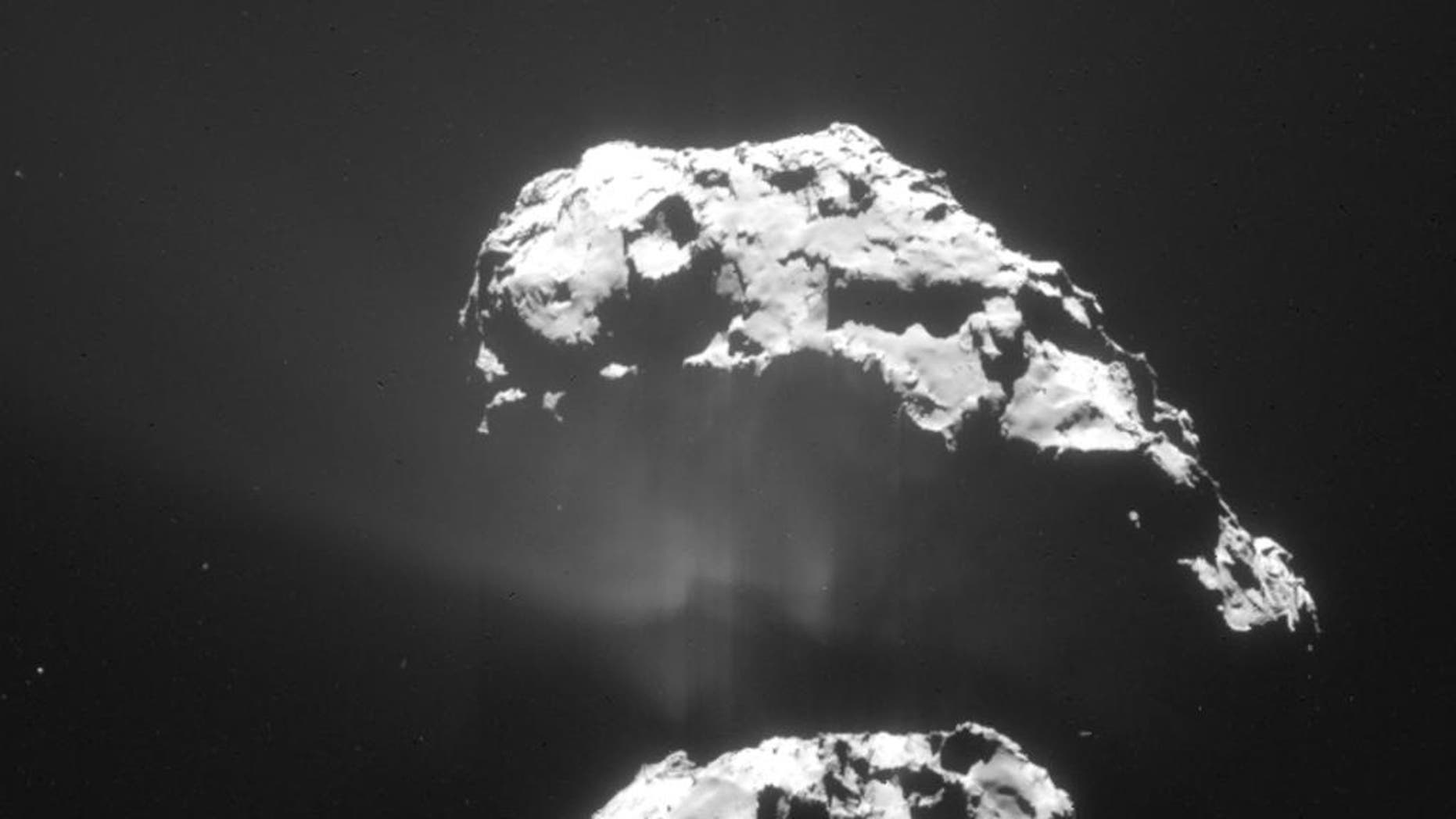 The Feb. 9, 2015 photo released by the European Space Agency ESA on Friday, Feb. 13, 2015 shows an image of the comet 67P/Churyumov-Gerasimenko taken by the Navcam camera of the Rosetta orbiter from a distance of 105km. The European Space Agency's Rosetta space probe has swooped in for a close look at the comet. Rosetta has been flying alongside the comet 67P/Churyumov-Gerasimenko and passed just 6 kilometers (less than 4 miles) above the comet's surface on Saturday, Feb. 14, 2015.  (AP Photo/ESA/Rosetta/Navcam)