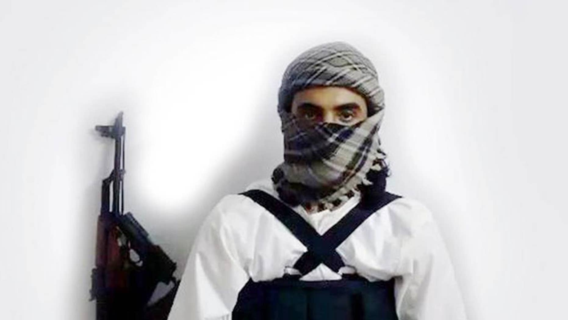 """FILE - This file image taken from a militant website associated with Islamic State extremists, posted Saturday, May 23, 2015, purports to show a suicide bomber,  with the Arabic bar below reading: """"Urgent: The heroic martyr Abu Amer al-Najdi, the attacker of the (Shiite) temple in Qatif"""",  which the Islamic State group's radio station claimed responsibility for.  Al-Bayan, the Islamic State radio targeting potential European recruits, touts recent triumphs in the campaign to carve out a Caliphate with contrast between the smooth, Western-style production and the extremist content showing how far the hardcore Islamic propaganda machine has come since its beginnings in 2012.  (Militant photo via AP, FILE)"""