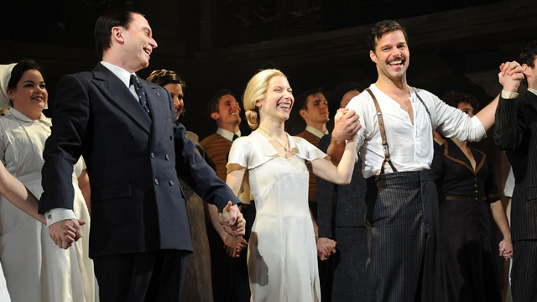March 12, 2012: Actors Michael Cerveris, Elena Roger and Ricky Martin attend the Broadway revival curtain call and press conference at the Marriott Marquis Hotel in New York City.