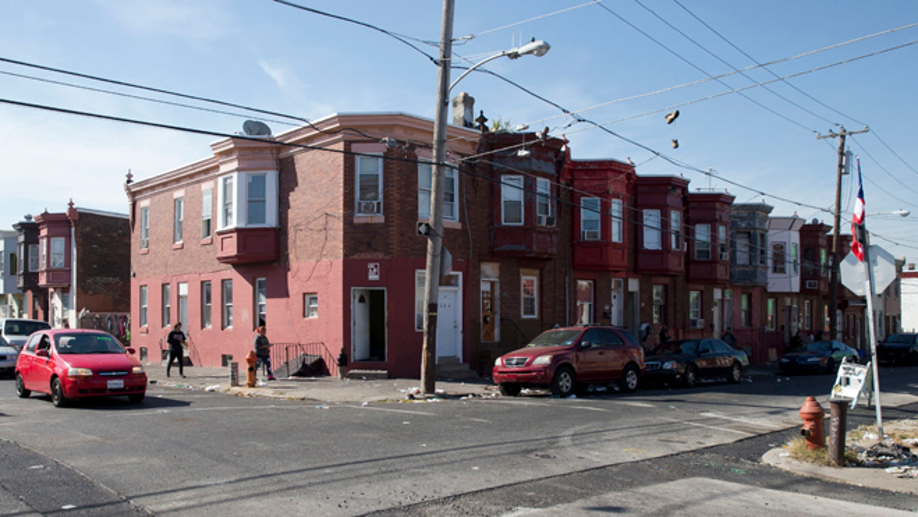 In this Wednesday, Oct. 21, 2015, photo, the intersection of Marshall and Tioga streets in Philadelphia is shown. Drug kingpin Myrna Suren ran a $100,000-a-week cocaine ring centered around this corner in Philadelphia's Hunting Park neighborhood in the 1980s, but is leaving prison soon after her life sentence was cut to 25 years under revised U.S. drug policies. She is one of 6,000 drug offenders leaving prison early this year. (AP Photo/Matt Rourke)
