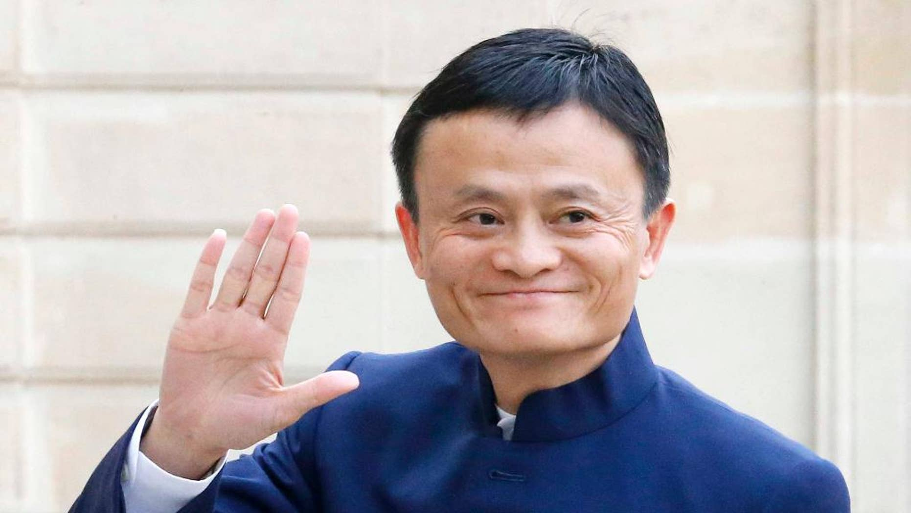 FILE - In this March 18, 2015 file photo, Jack Ma, founder and CEO of the Alibaba Group, arrives at the Elysee Palace, in Paris. Alibaba reports quarterly financial results on Thursday, May 7, 2015. (AP Photo/Jacques Brinon, File)