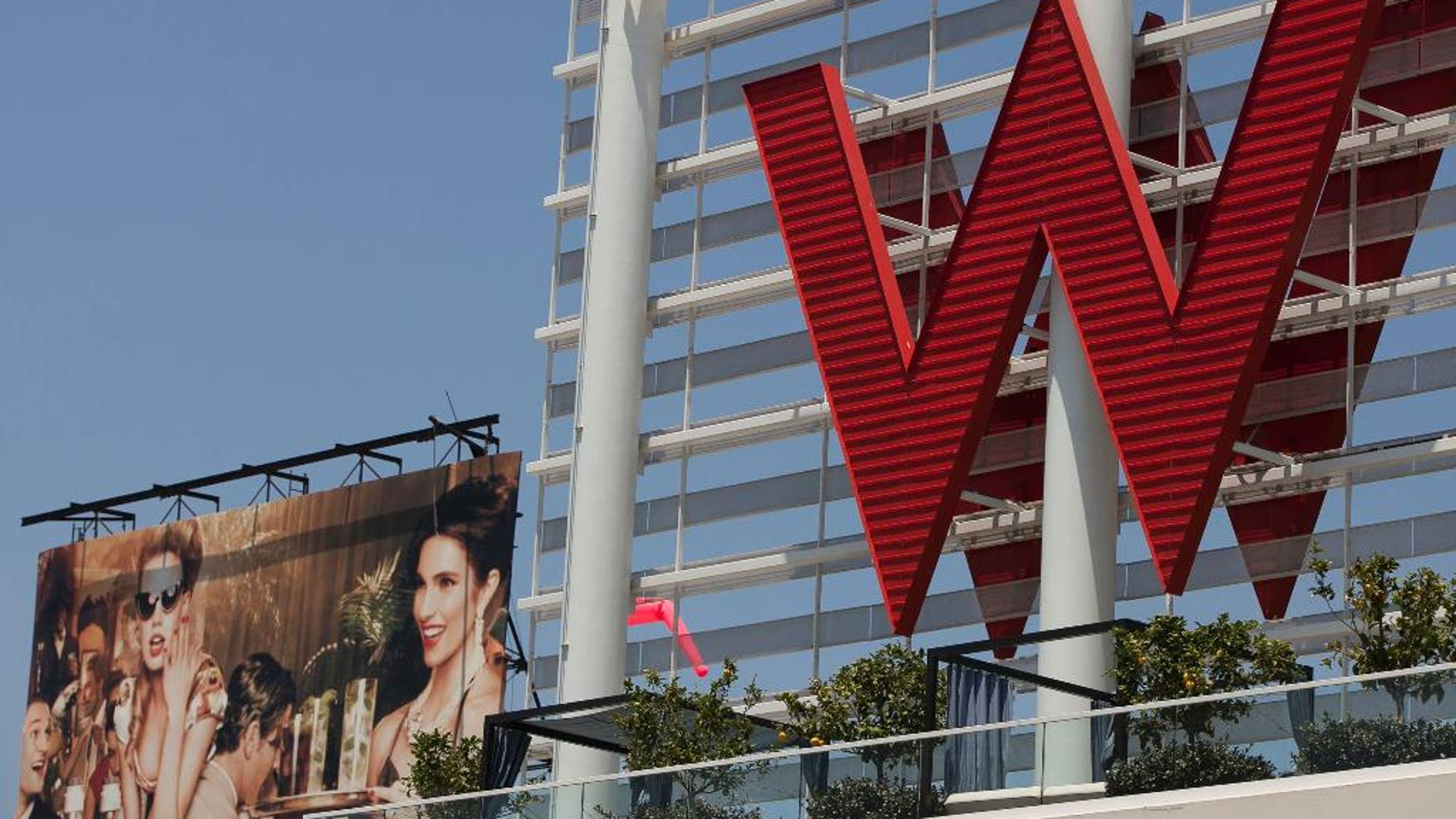 FILE - A Tuesday, July 17, 2012 file photo, shows Starwood Hotels  W Hollywood hotel logo in Los Angeles.  Starwood Hotels & Resorts Worldwide Inc. reports quarterly earnings on Thursday, April 24, 2014.  (AP Photo/Damian Dovarganes, File)