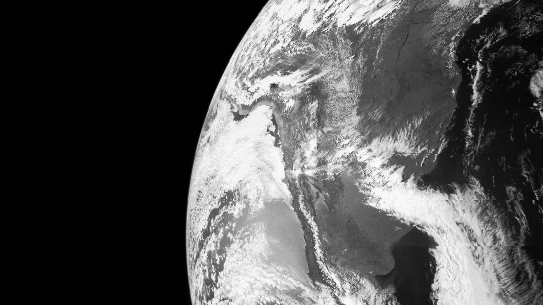 Earth is seen in this image taken by NASA's JunoCam as it flew by Earth, using its gravity to get a boost needed to reach Jupiter on October 9, 2013, in this NASA handout image released to Reuters.