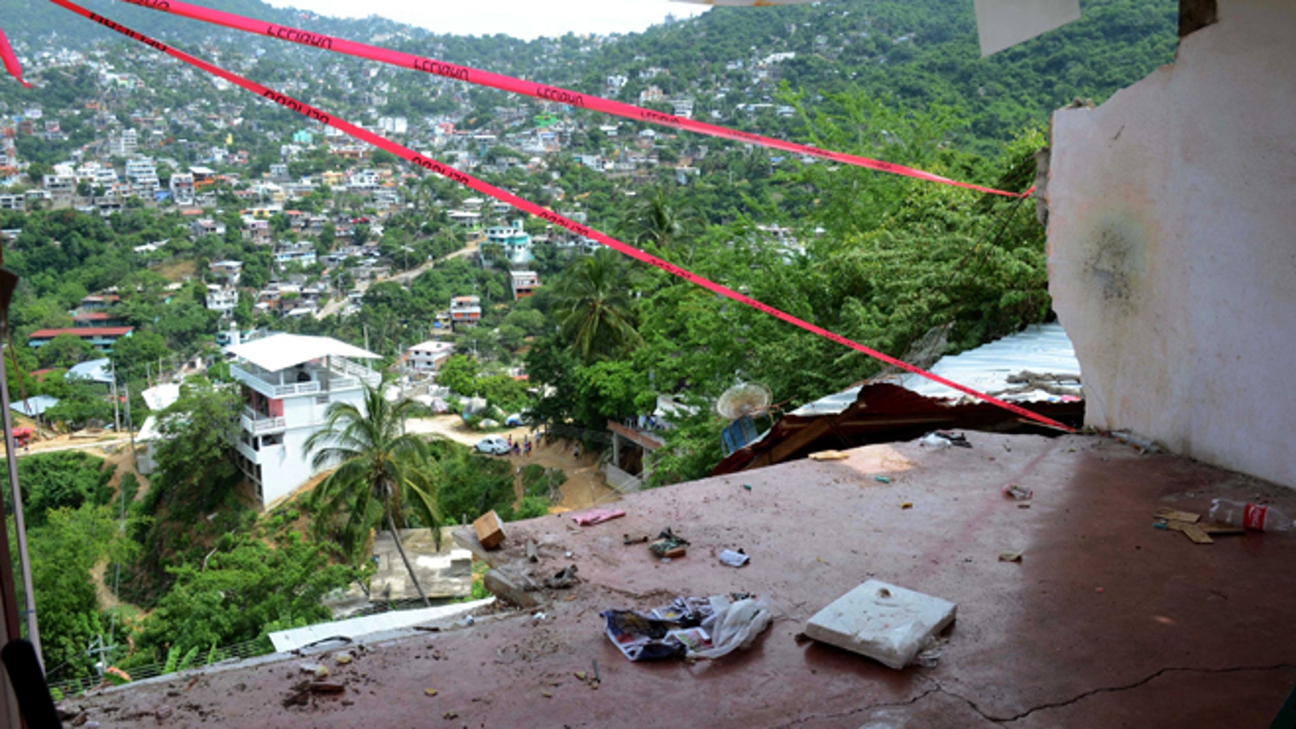 Aug 21, 2013: The wall of a home is missing after it fell during an earthquake in Acapulco. The U.S. Geological Survey said the quake had a magnitude of 6.2 and was centered on the Pacific coast, near the resort of Acapulco.