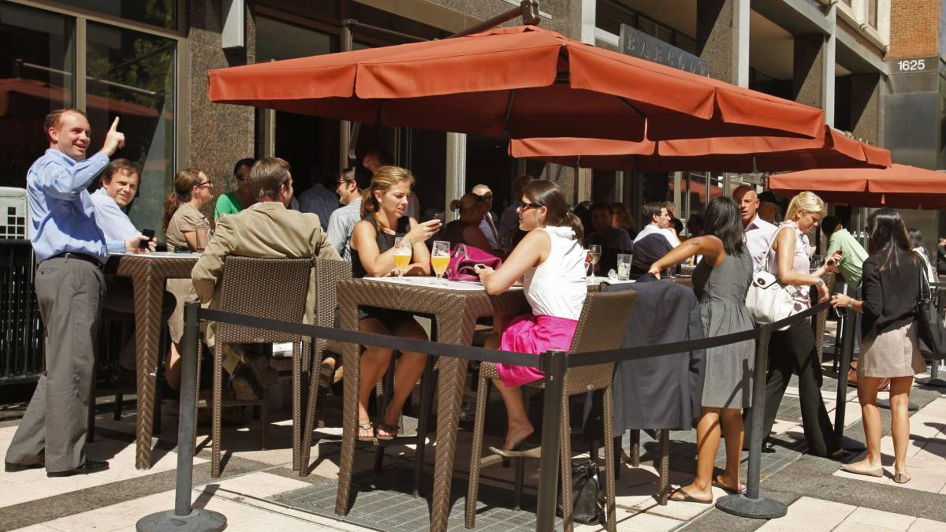 People have drinks at an outdoor cafe on L Street NW in Washington, Tuesday, Aug. 23, 2011, after an earthquake hit the Washington area, evacuating buildings. (AP Photo/Jacquelyn Martin)