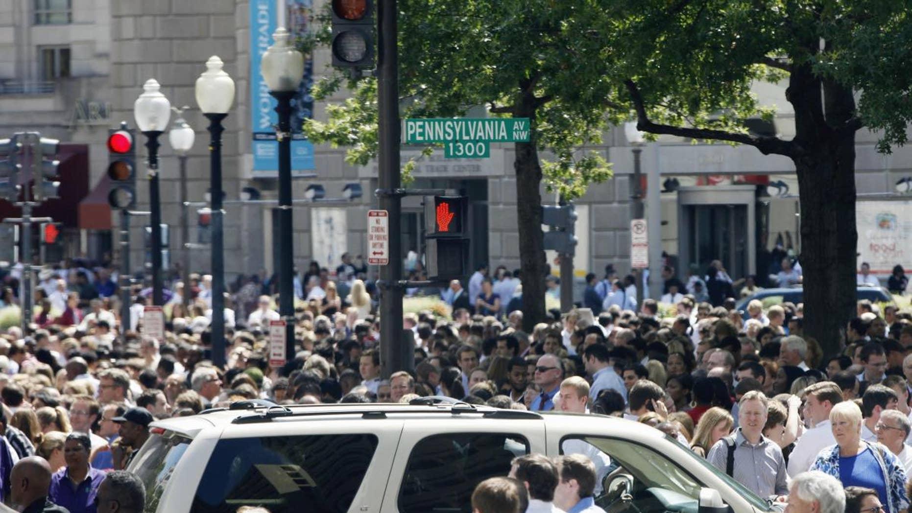People crowd Pennsylvania Avenue in Washington, Tuesday, Aug. 23, 2011, as buildings were evacuated following an earthquake. (AP Photo/Charles Dharapak)