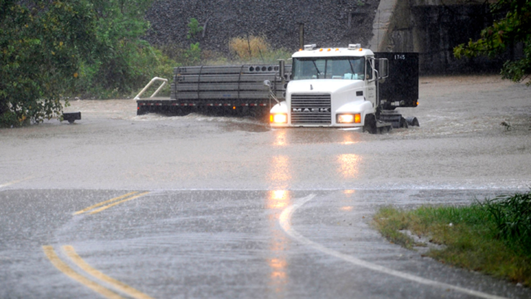Sept. 30, 2010: A truck makes its way through a rising Stemmers Run on Golden Ring Road in east Baltimore County, Md. A massive rainstorm drenched the East Coast from the Carolinas to Maine, washing out commutes and wiping away months of dry weather.