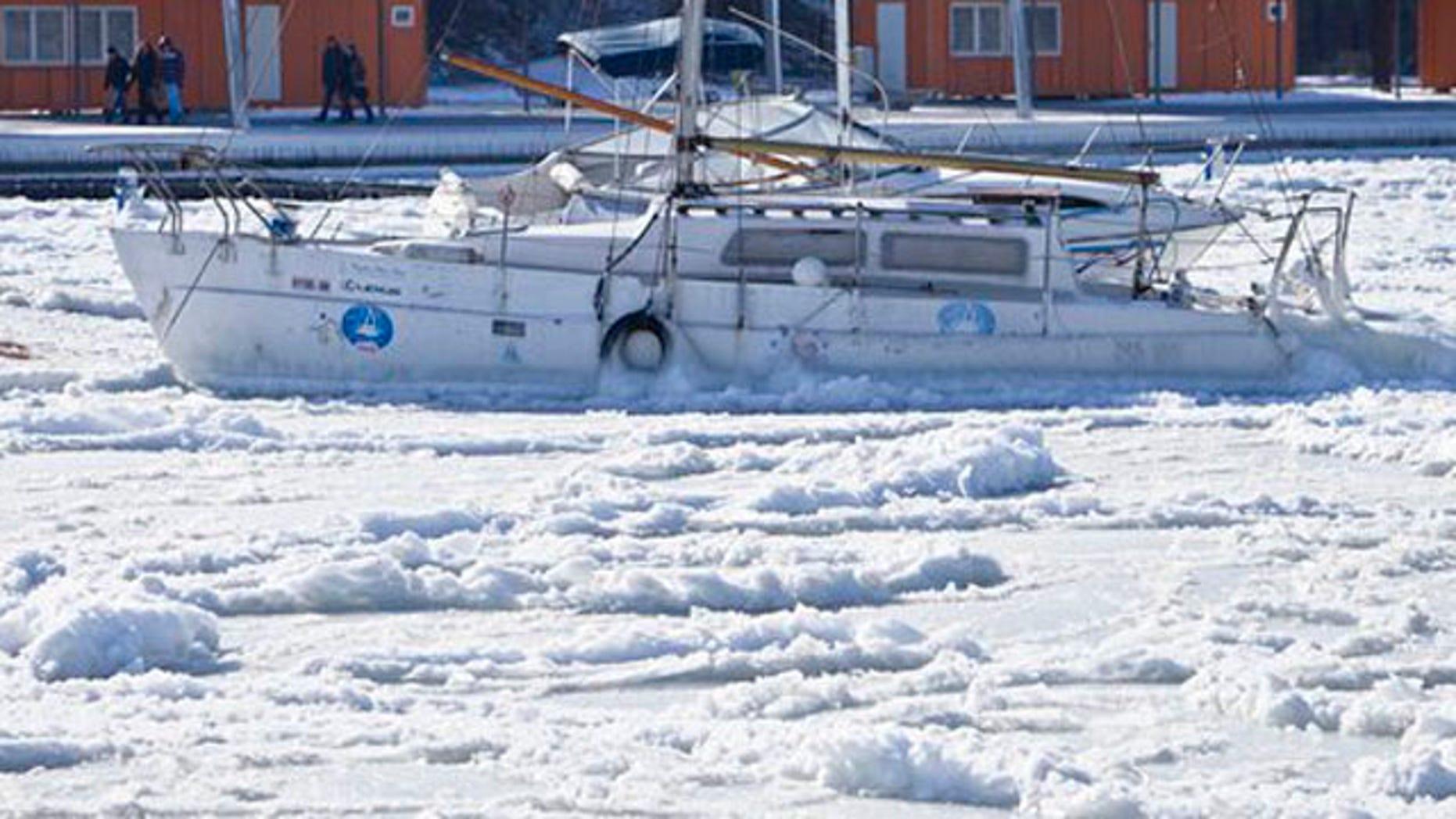 Feb. 2, 2012: Ice engulfs a boat as the Black Sea is frozen near the shore in Constanta, Romania.