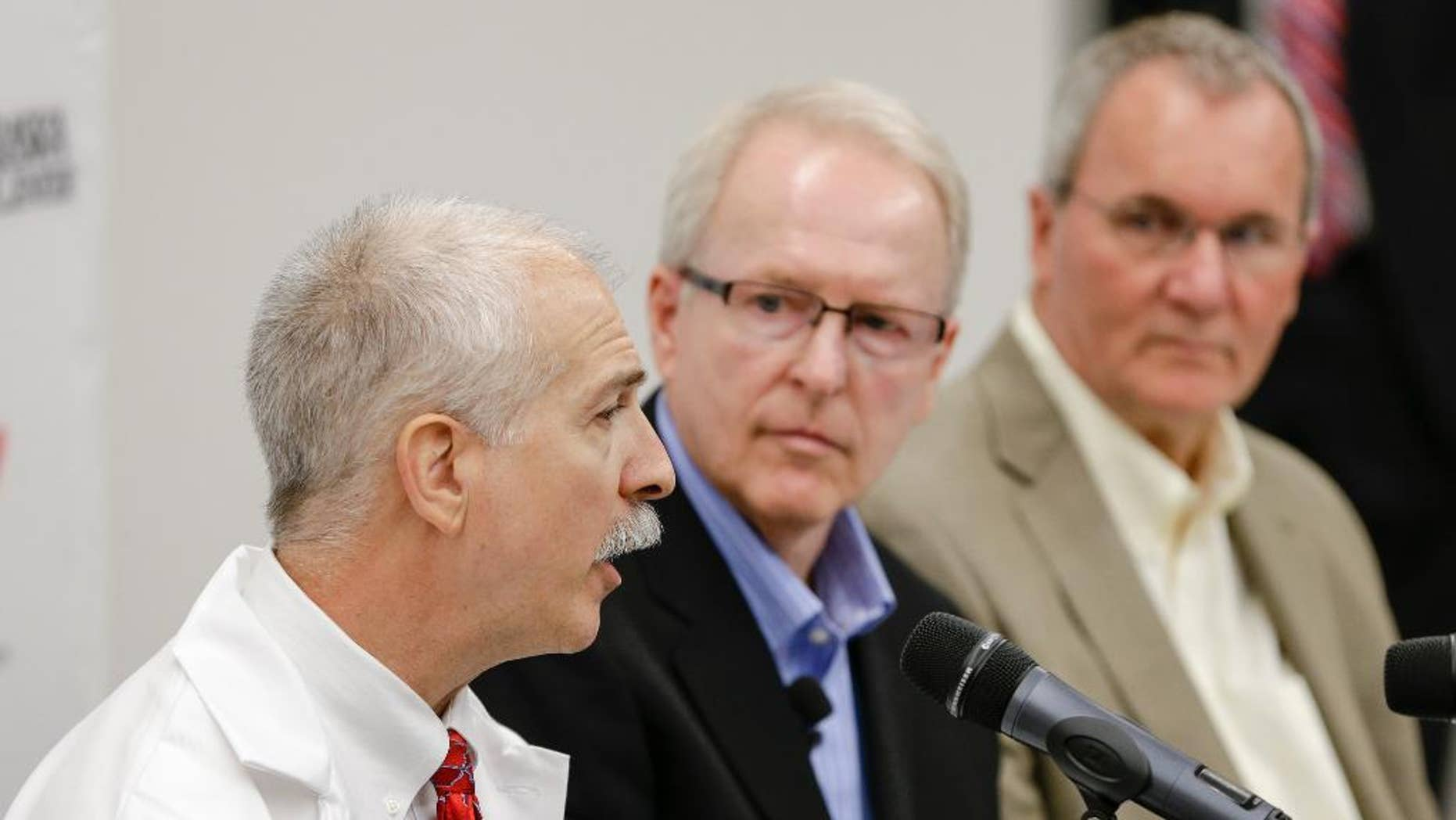 Dr. Mark Rupp, chief of the division of infectious diseases in the department of internal medicine at the Nebraska Medical Center, left, speaks as SIM USA President Bruce Johnson, center, and SIM Liberia country director Will Elphick, right, listen, at a news conference in Omaha, Neb., Friday Sept. 5, 2014, on the condition of ebola patient Dr. Rick Sacra, 51, who is treated at the center. Sacra, who served with North Carolina-based charity SIM, is the third American aid worker infected by the Ebola virus. He will begin treatment  in the hospital's 10-bed special isolation unit, the largest of four such units in the U.S. (AP Photo/Nati Harnik)