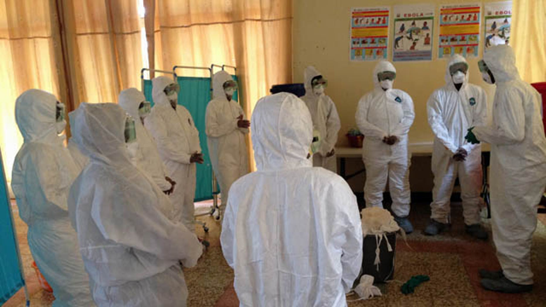 This photo provided by Dr. Dan Lucey, of the Georgetown University Medical Center, shows a session he supervised in Sierra Leone to train local health workers how to properly put on and take off equipment to protect against the Ebola virus.  (AP Photo/Dan Lucey)