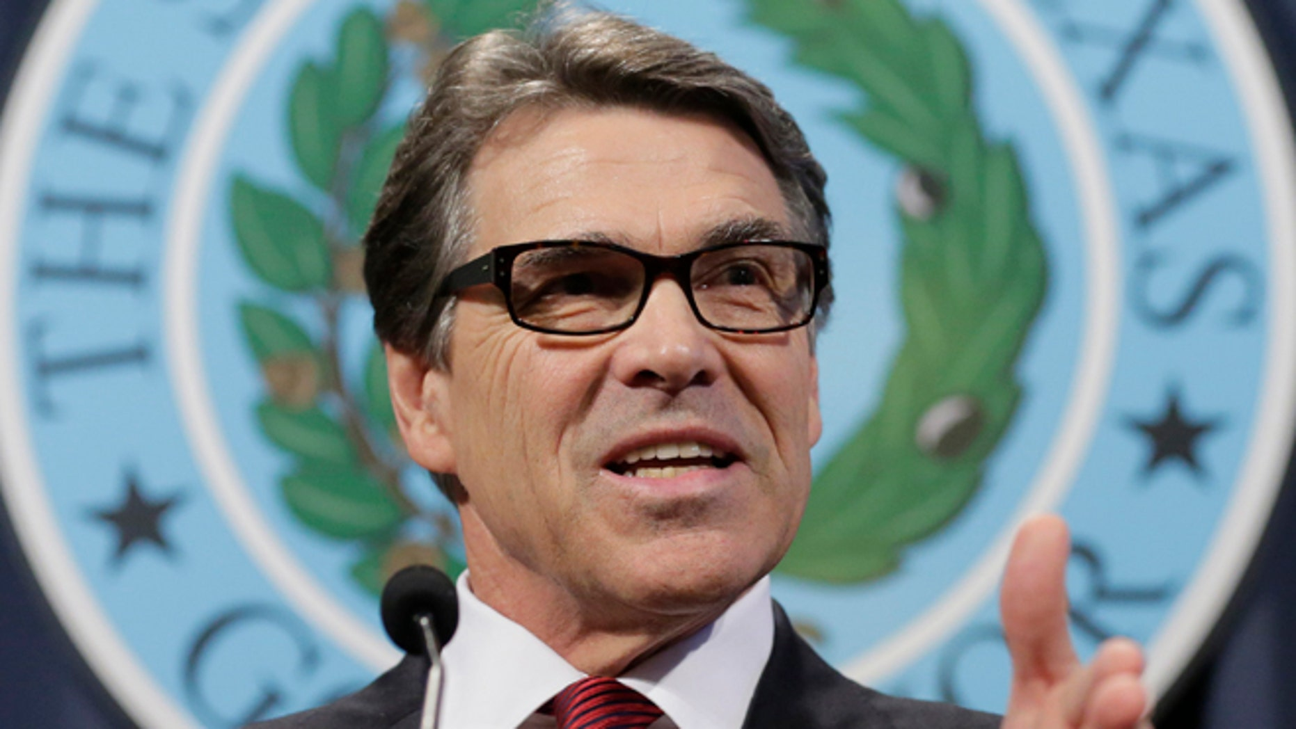 In this Friday, Oct. 17, 2014 photo, Texas Gov. Rick Perry answers questions during a news conference to discuss Texas Ebola prevention efforts in Austin, Texas.
