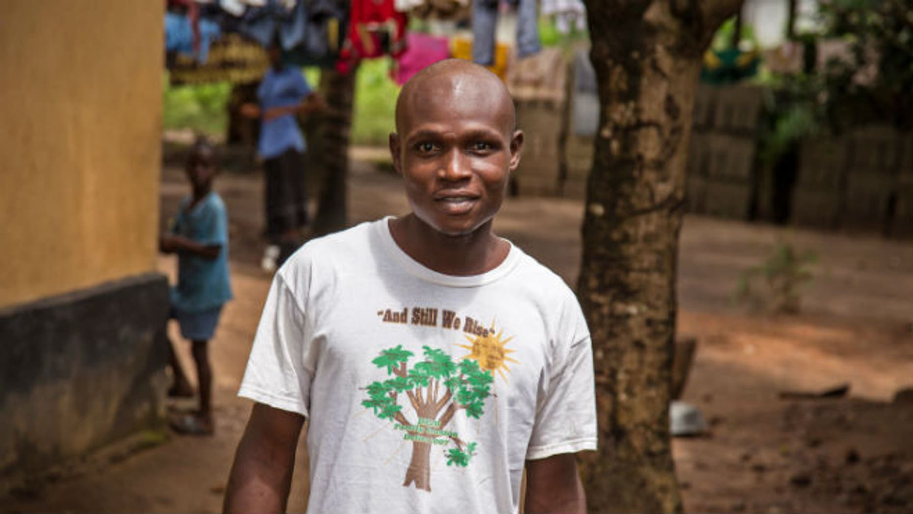 In this photo taken Monday, Aug. 11, 2014, Sulaiman Kemokai, an Ebola virus survivor near his house in the Heigbema Village in Kenema situated in the Eastern Province around 300km, (186 miles), from the capital city of Freetown in Kenema, Sierra Leone. (AP Photo/ Michael Duff)