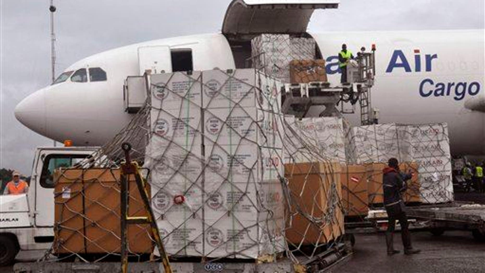 American Aid goods are offloaded from an airplane, to be used in the fight against the Ebola virus spreading in the city of  Monrovia, Liberia, Sunday, Aug. 24, 2014.