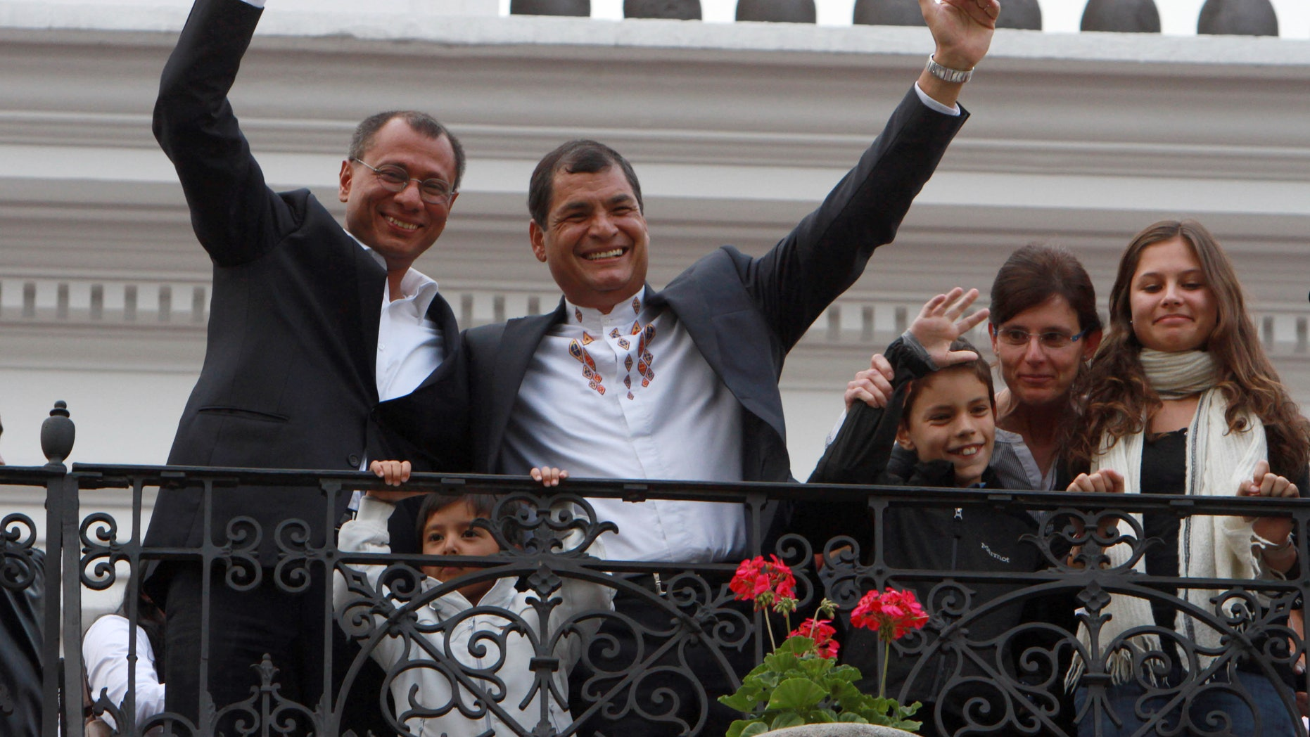 Feb. 17, 2013: Ecuador's President and candidate for re-election Rafael Correa, top right, and vice presidential candidate Jorge Glass, top left, accompanied by relatives, celebrate after presidential elections in Quito, Ecuador.