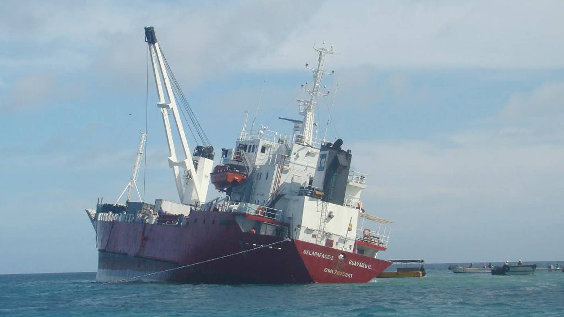 This Friday, May 9, 2014 photo, released by Galapagos National Park, shows the freighter Galapaface I that ran aground in the bay adjacent to San Cristobal island, in the Galapagos Islands. Ecuadorean authorities said Friday, May 16, 2014, they have offloaded all the fuel and most of the cargo from the freighter, and it will take three to four weeks to refloat and rescue the ship. (AP Photo/Galapagos National Park)