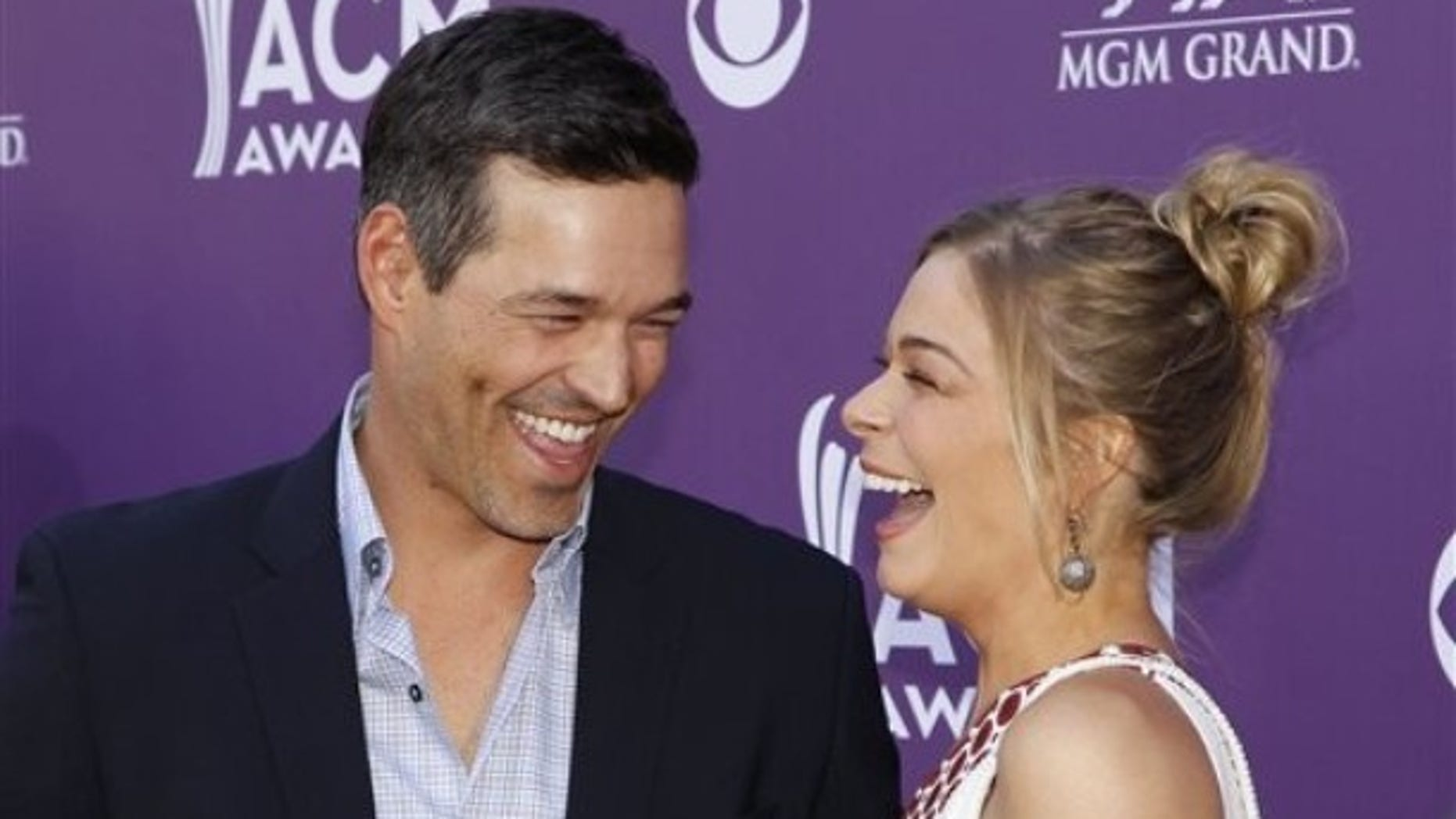 LeAnn Rimes, right, and Eddie Cibrian arrive at the 47th Annual Academy of Country Music Awards on Sunday, April 1, 2012 in Las Vegas. (AP Photo/Isaac Brekken)