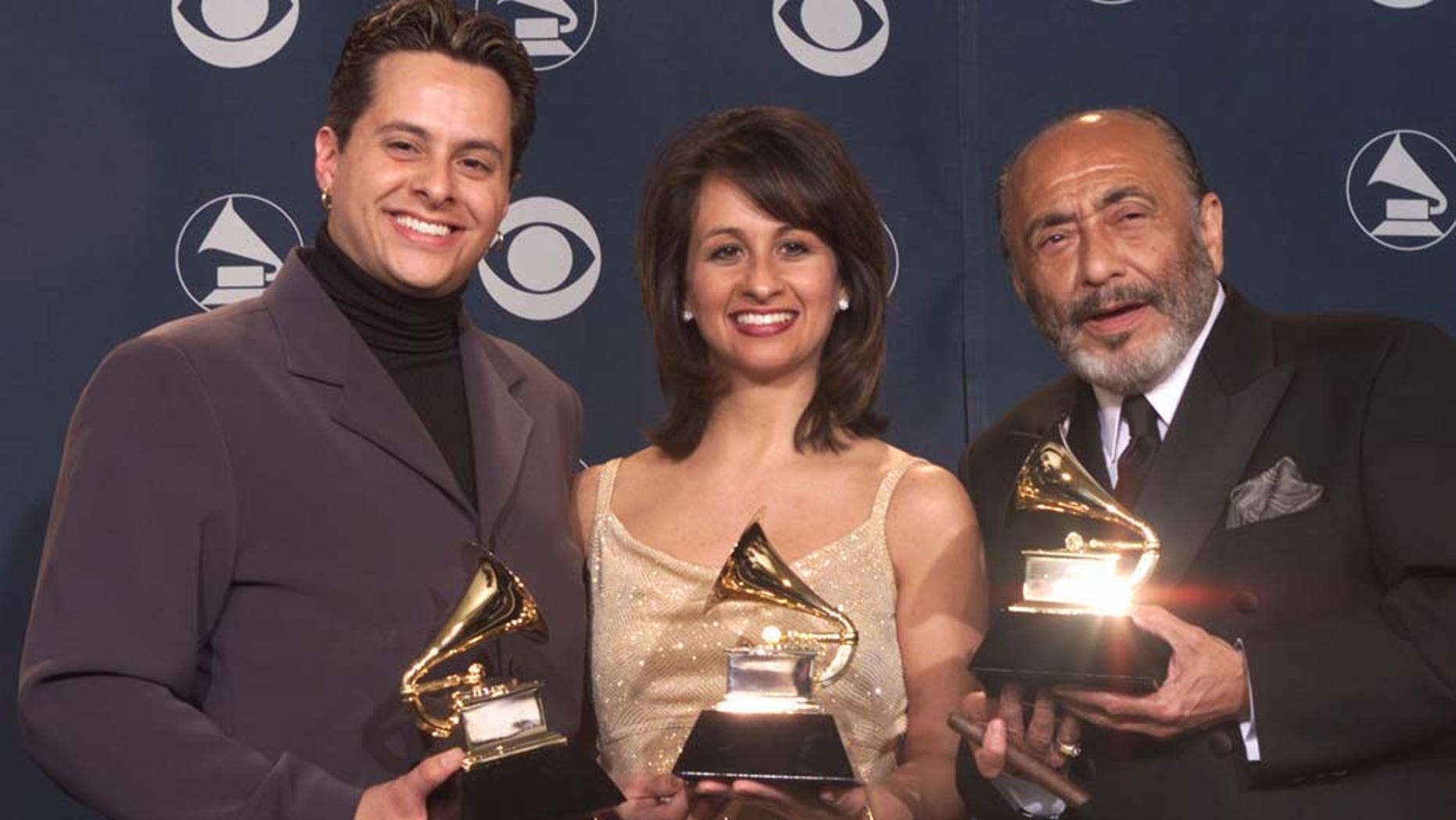 Tito Puente Jr.(left), sister Audrey, and Eddie Palmieri pose with Grammys for Best Salsa Album backstage at the 43rd Annual Grammy Awards at Staples Center in Los Angeles Wednesday, Feb. 21, 2001.