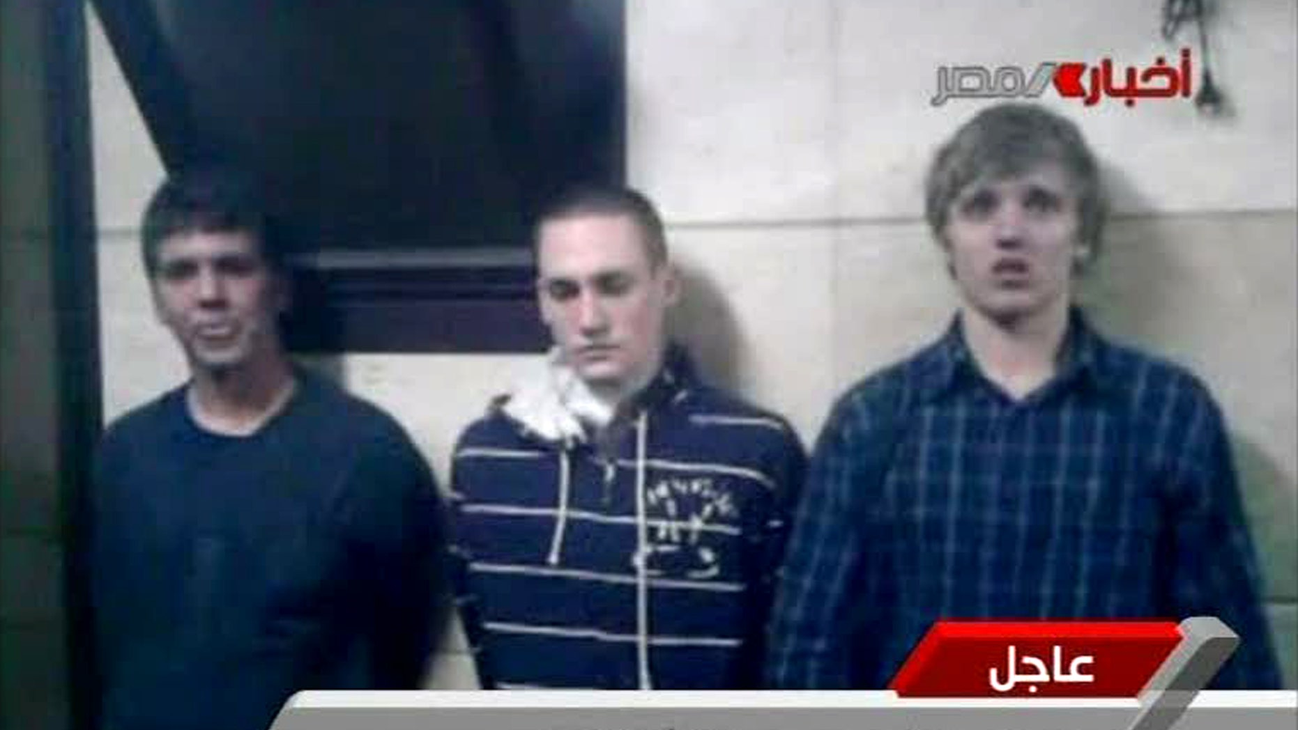 Nov 22 2011: Three American students are displayed to the camera by Egyptian authorities following their arrest during protests in Cairo, where an Egyptian official said they were throwing firebombs at security forces.