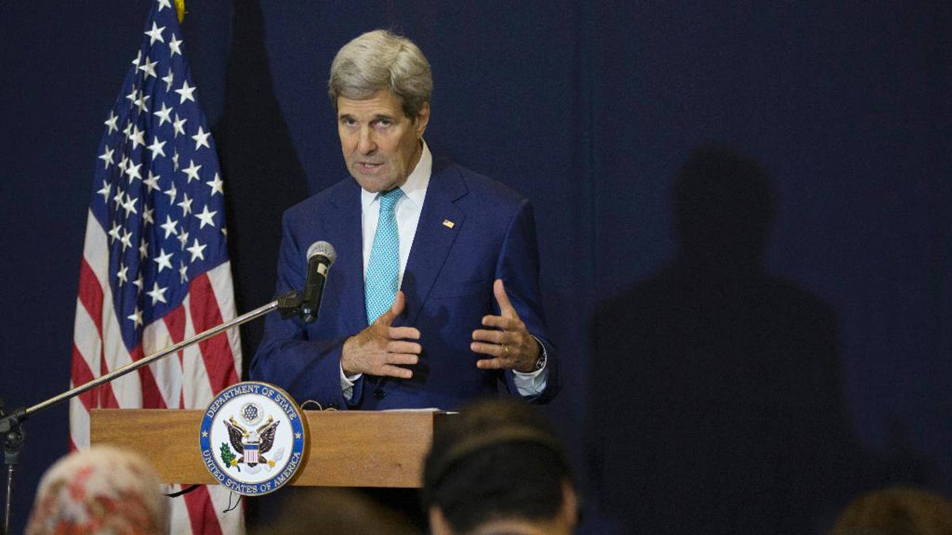"""U.S. Secretary of State John Kerry speaks at a news conference in Sharm el-Sheikh in Egypt Saturday, March 14, 2015, after attending the Egypt Economic Development Conference the previous day. Kerry says he hopes Israel elects a government that can address the country's domestic needs and also """"meets the hope for peace."""" (AP Photo/Brian Snyder, Pool)"""