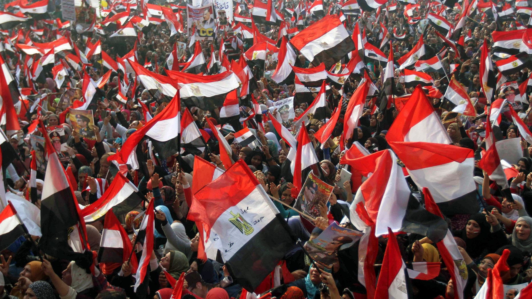 Jan. 25, 2014: Supporters of Egypt';s army and police gather at Tahrir square in Cairo, on the third anniversary of Egypt's uprising.