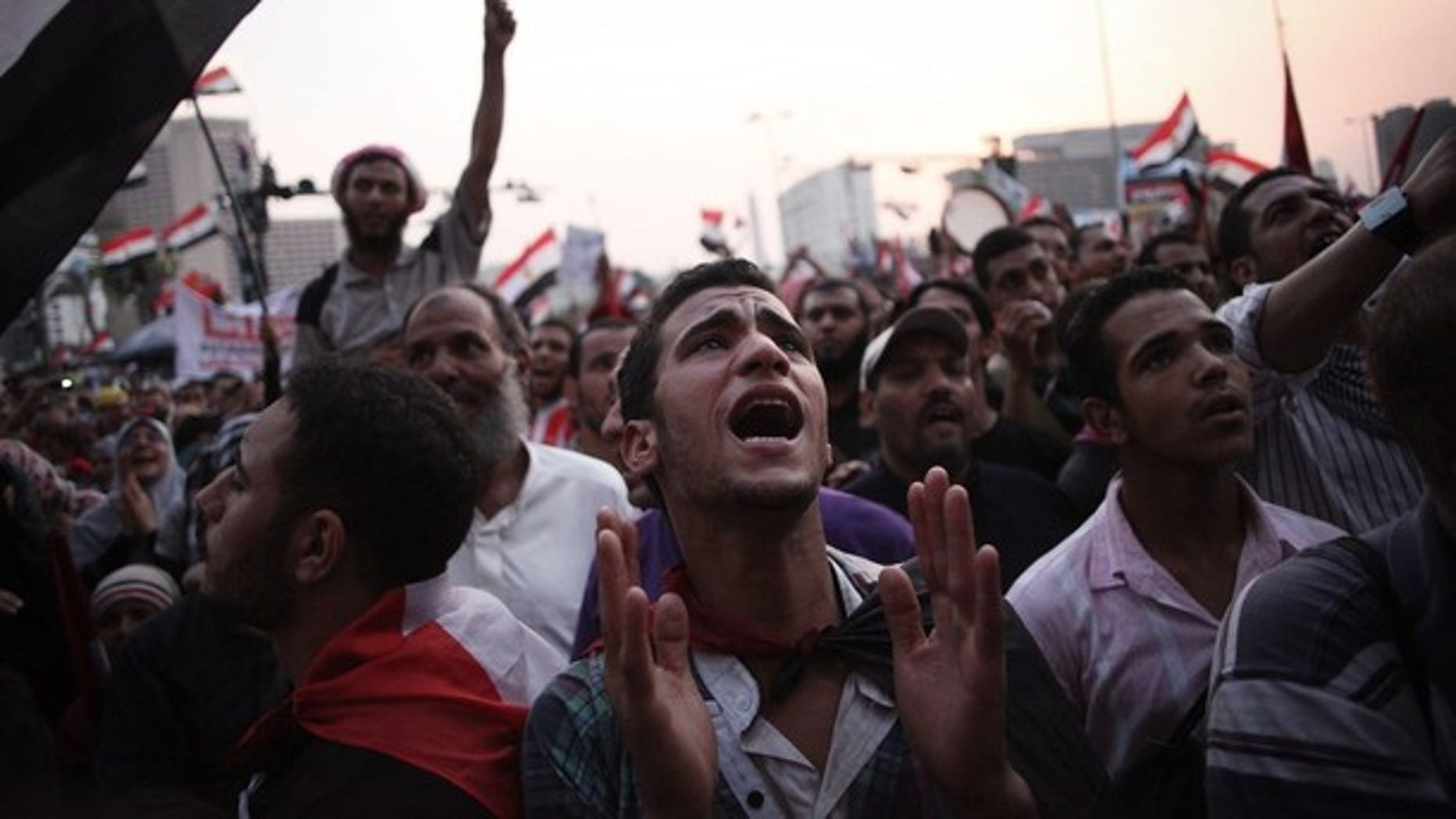 June 23, 2012: Egyptian protesters shout slogans in Tahrir Square as the country awaits the outcome of a presidential runoff vote.