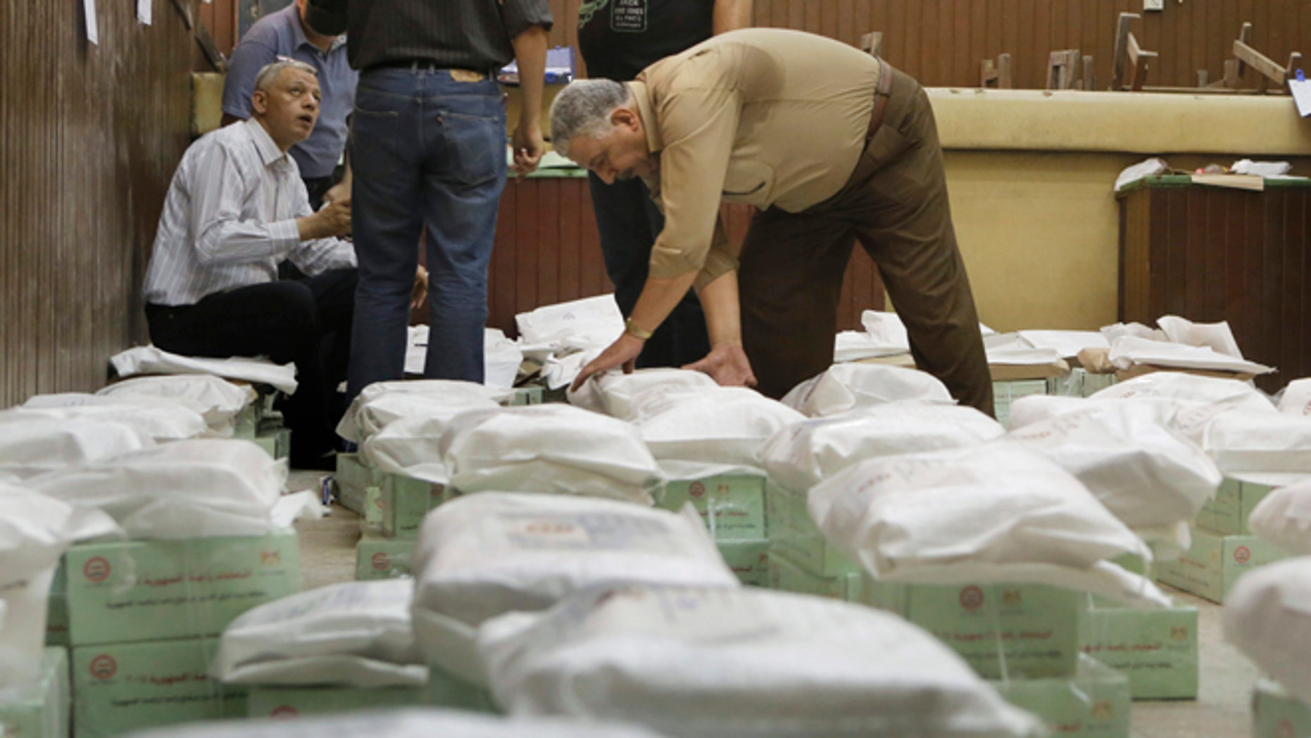May 25, 2014: An Egyptian worker arranges boxes of ballots at the Giza courthouse a day before the country's two-day presidential elections begins, in Cairo, Egypt. (AP)