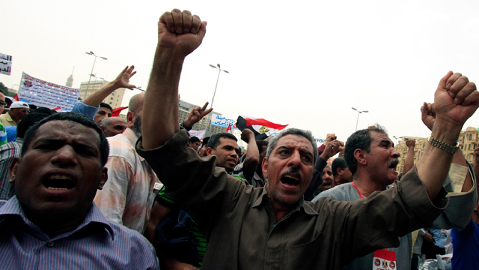 May 27: Egyptian protesters chant slogans as they attend a rally in Tahrir square in Cairo, Egypt. Activists are pressing Egypt's military rulers to investigate accusations of sexual abuses against protesters.