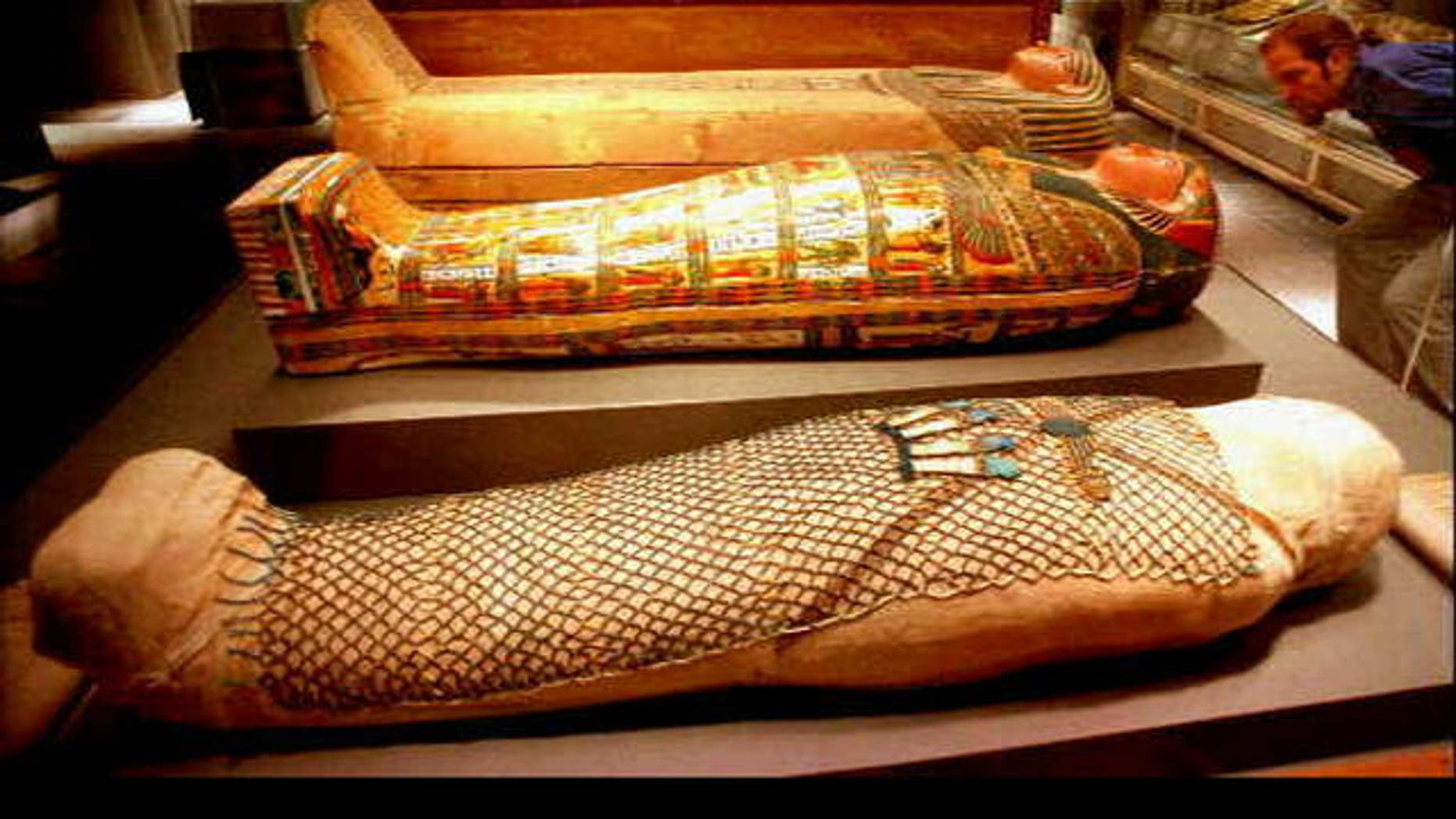 An Egyptian mummy shown in three stages (AP)