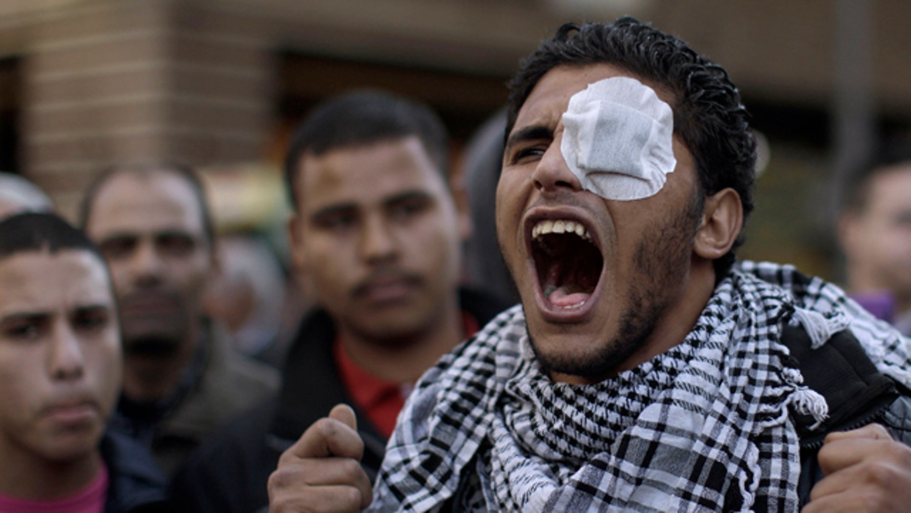 Jan. 31: An Egyptian protestor shouts slogans during a rally outside the Parliament in Cairo.