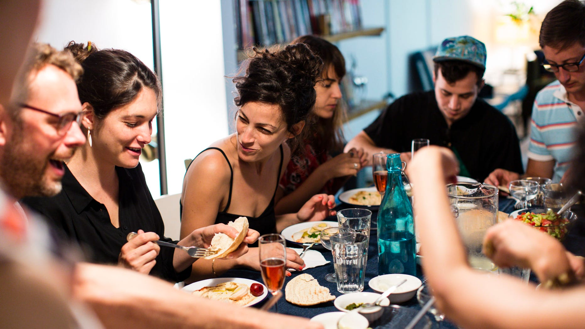 An EatWith group sharing a Middle Eastern brunch in Manhattan.