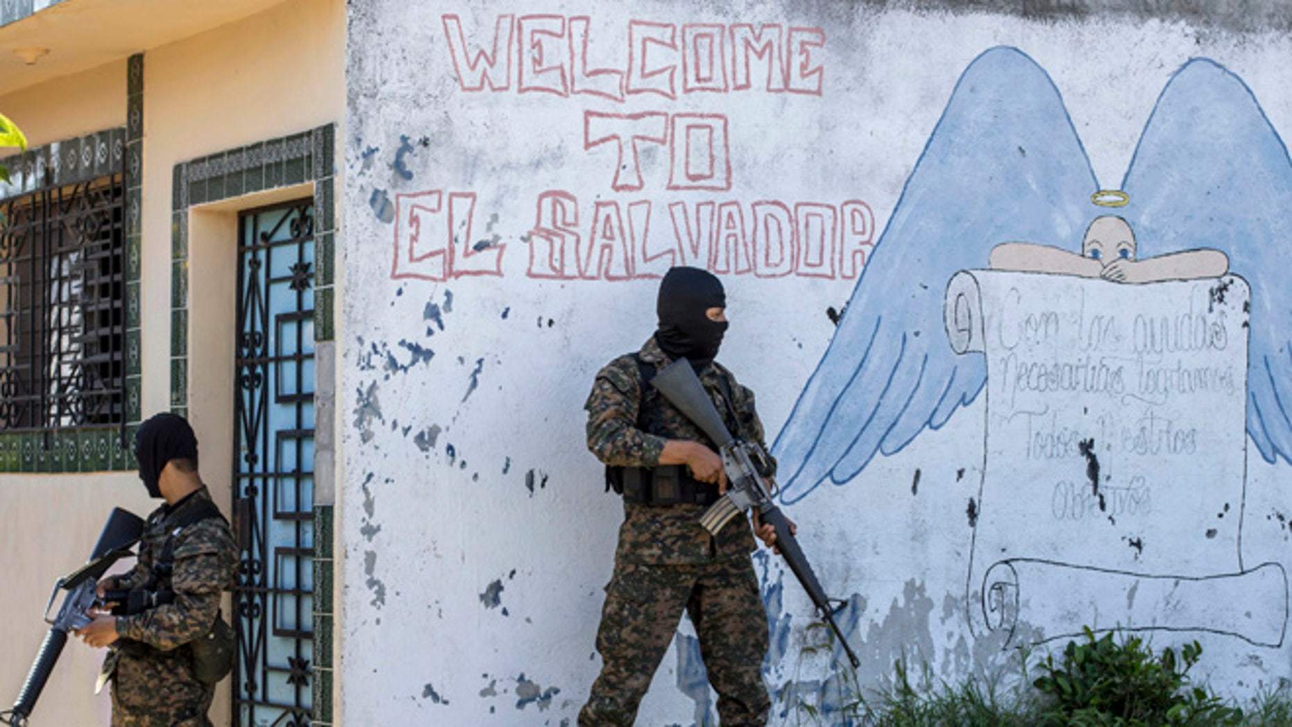 FILE - In this Aug. 31, 2015 file photo, soldiers guard a corner in a gang-controlled neighborhood in Ilopango, El Salvador. A video broadcast by local media on Saturday, March 26, 2016, purportedly made by the countryâs main street gangs, is offering an end to killings, and asks the government not to continue an anti-gang offensive. Officials said they would not negotiate with the gangs. (AP Photo/Salvador Melendez, File)