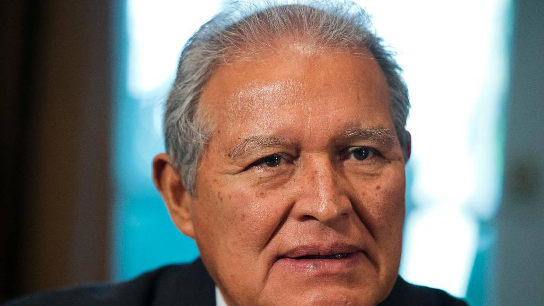 FILE - In this July 25, 2014 file photo, El Salvador's President Salvador Sanchez Ceren, listens as U.S. President Barack Obama speaks to the media, in the Cabinet Room of the White House, in Washington. Ceren on Saturday, Aug. 29, 2015, praised a local Supreme Court ruling declaring the gangs known as maras terrorists. ìNow the persecution of crime will be more effective, the gangs now are terrorists and all the force of the law will be applied against them.î He said it would also make it easier to prosecute those who collaborate with the gangs. (AP Photo/File)