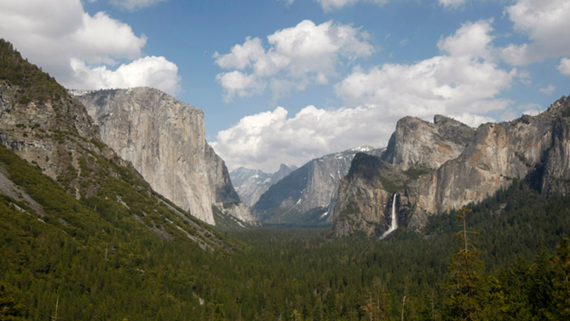 A climber was stuck 230 below the summit of El Capitan, seen on the left, during California's first winter snowstorm of the season struck.