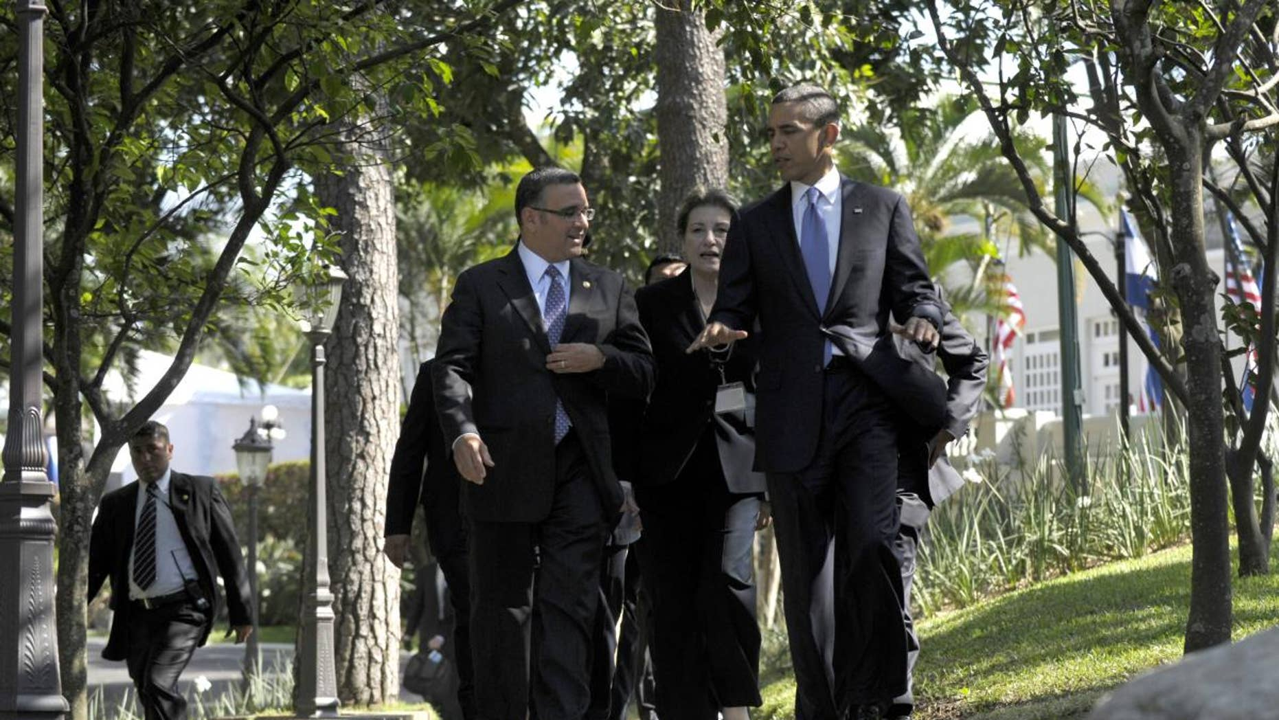 President Barack Obama and President of El Salvador President Mauricio Funes walk to a joint press conference at the Casa Presidential in San Salvador, El Salvador, Tuesday, March 22, 2011. (AP Photo/Susan Walsh)