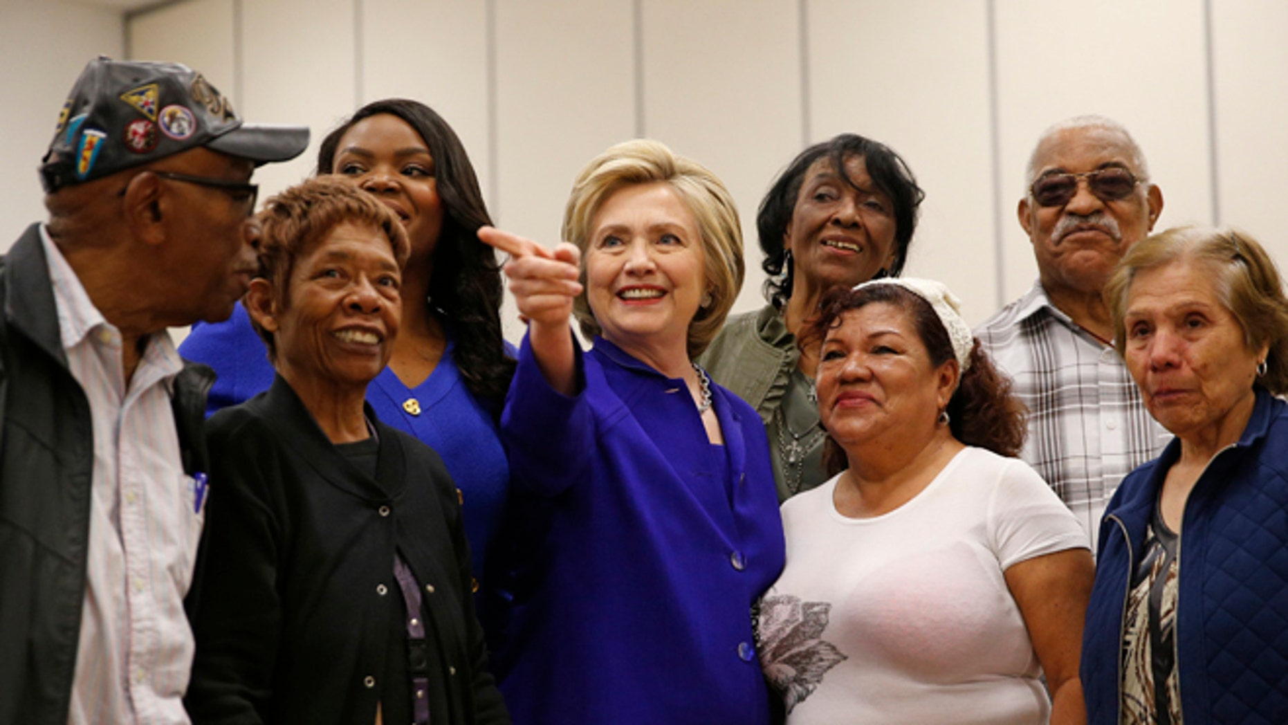 FILE - In this Monday, June 6, 2016 file photo, Democratic presidential candidate Hillary Clinton, center, visits a community center, Monday, June 6, 2016, in Compton, Calif. State officials are preparing to embrace an expanded California electorate Tuesday as nearly 18 million registered voters head for the polls or turn in early presidential primary ballots. (AP Photo/John Locher, File)